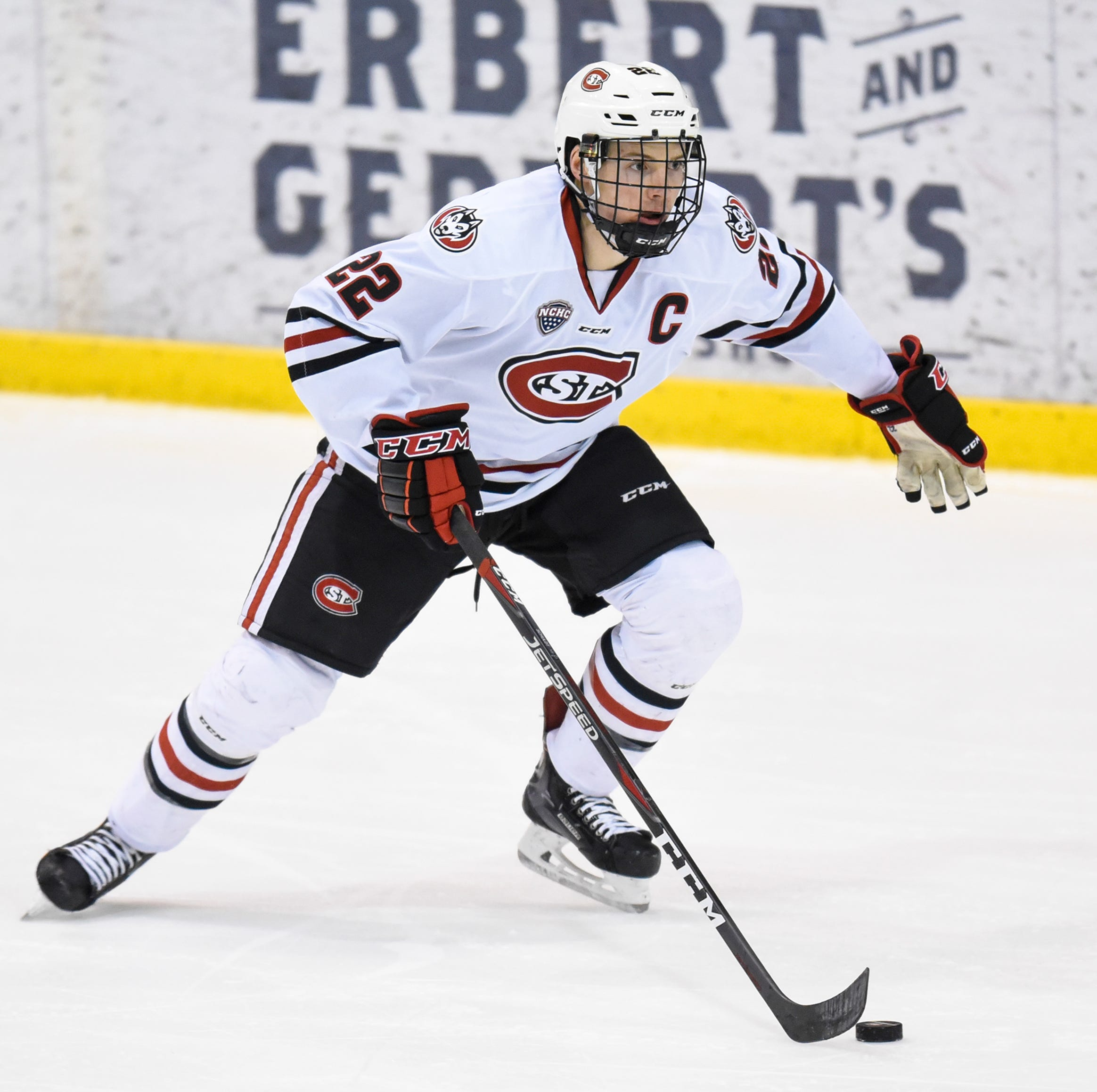 St. Cloud State's Jimmy Schuldt advances with the puck during the first period of the Friday, Feb. 8, game at the Herb Brooks National Hockey Center in St. Cloud.