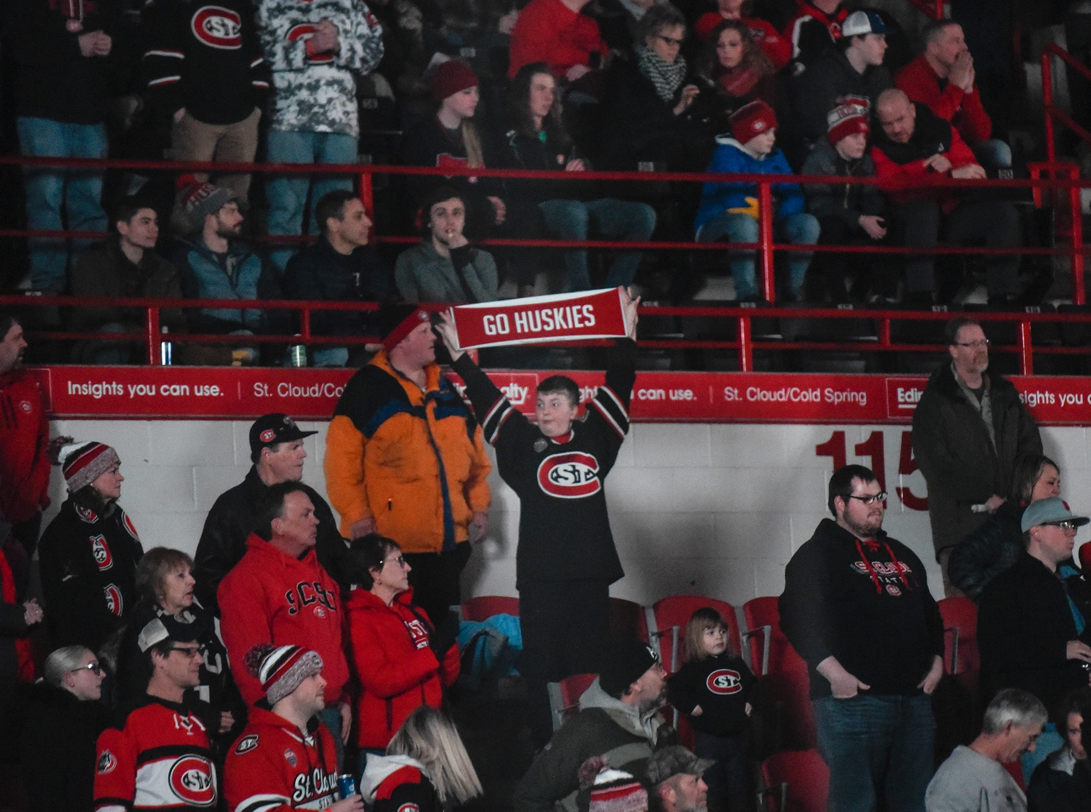 A fan holds a sign during the first period of the Friday, Feb. 8, game at the Herb Brooks National Hockey Center in St. Cloud.