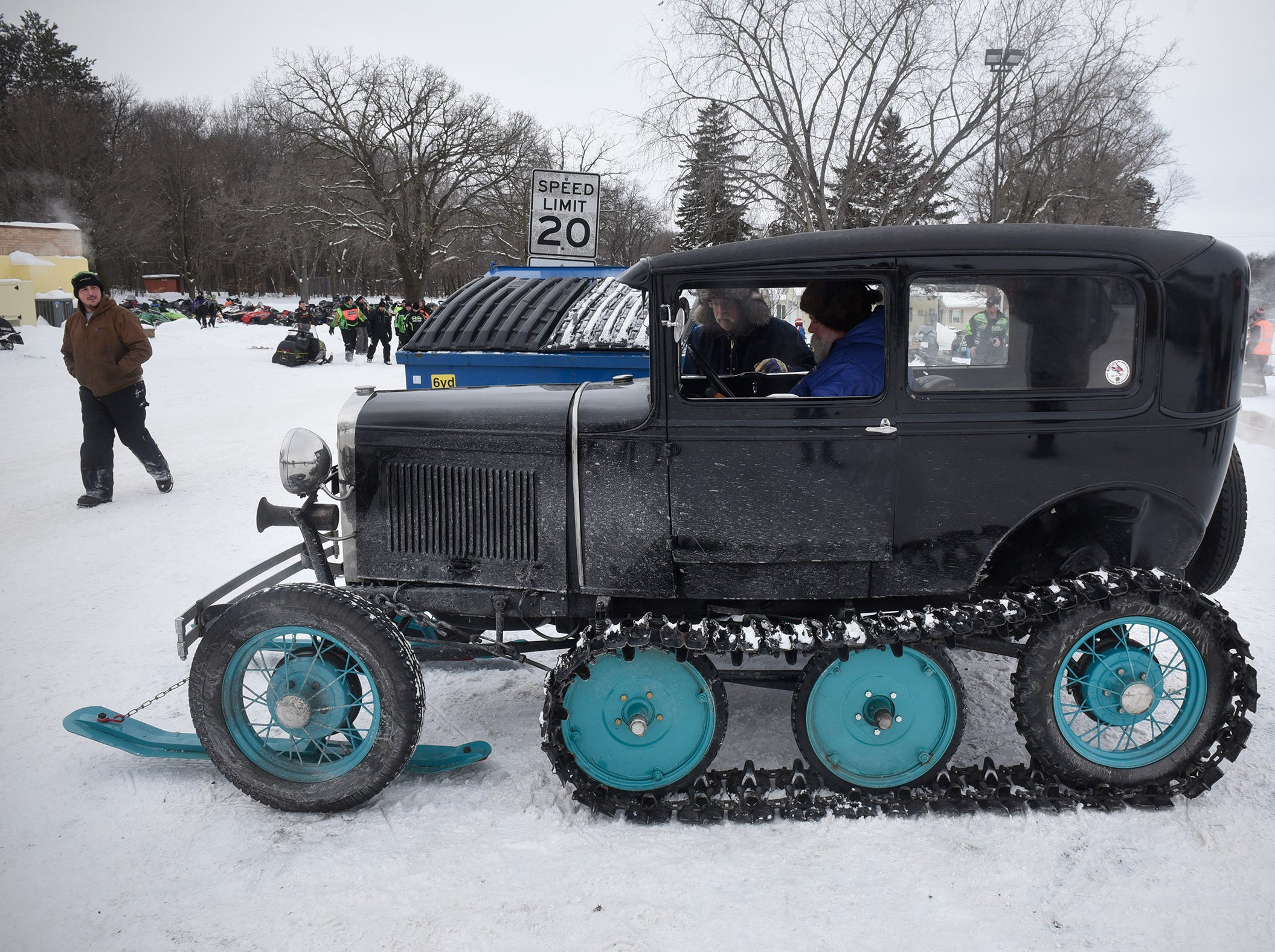 Jasper Bond starts his 1930 Model A Ford with a Super Snowbird kit installed Saturday, Feb. 9, during the St. Stephen River Runners snowmobile club's 50th Anniversary Celebration in St. Stephen.  The vehicle was originally used to carry the U.S. Mail in the winter.