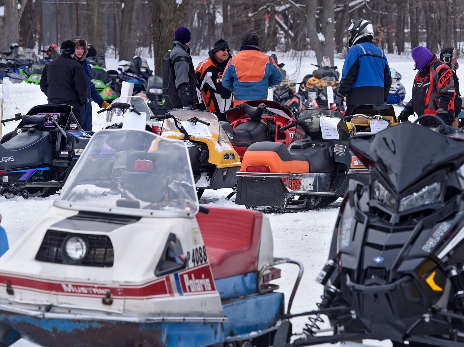 People gather for a vintage snowmobile show and trail ride Saturday in St. Stephen.