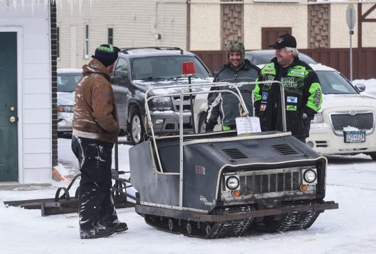 People view the St. Stephen River Runners 1969 original trail grooming machine Saturday, Feb. 9, during the club's 50th anniversary celebration in St. Stephen.