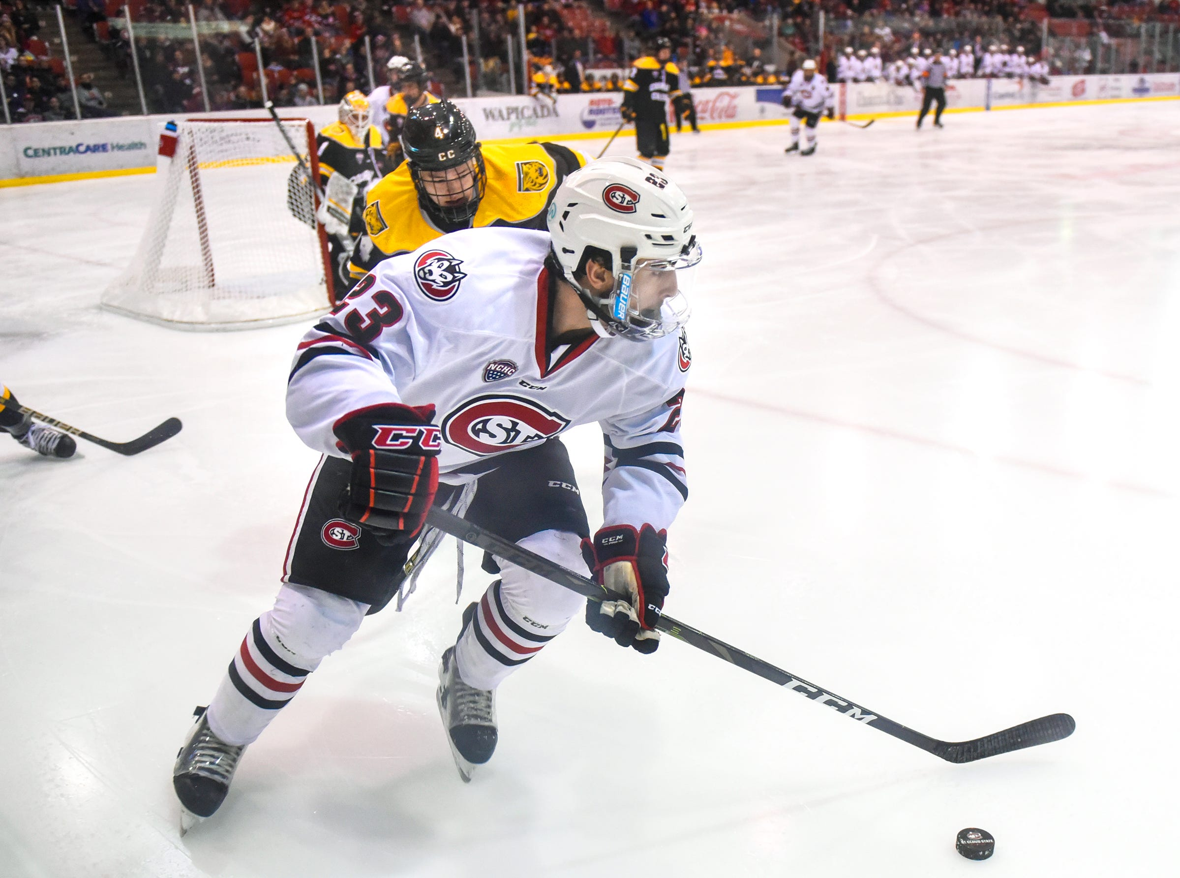 St. Cloud State's Robby Jackson works with the puck near the Colorado College goal during the first period of the Friday, Feb. 8, game at the Herb Brooks National Hockey Center in St. Cloud.