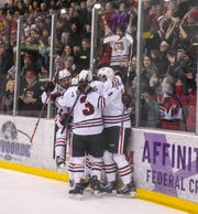 St. Cloud State players celebrate a goal during the first period of the Friday, Feb. 8, game at the Herb Brooks National Hockey Center in St. Cloud.