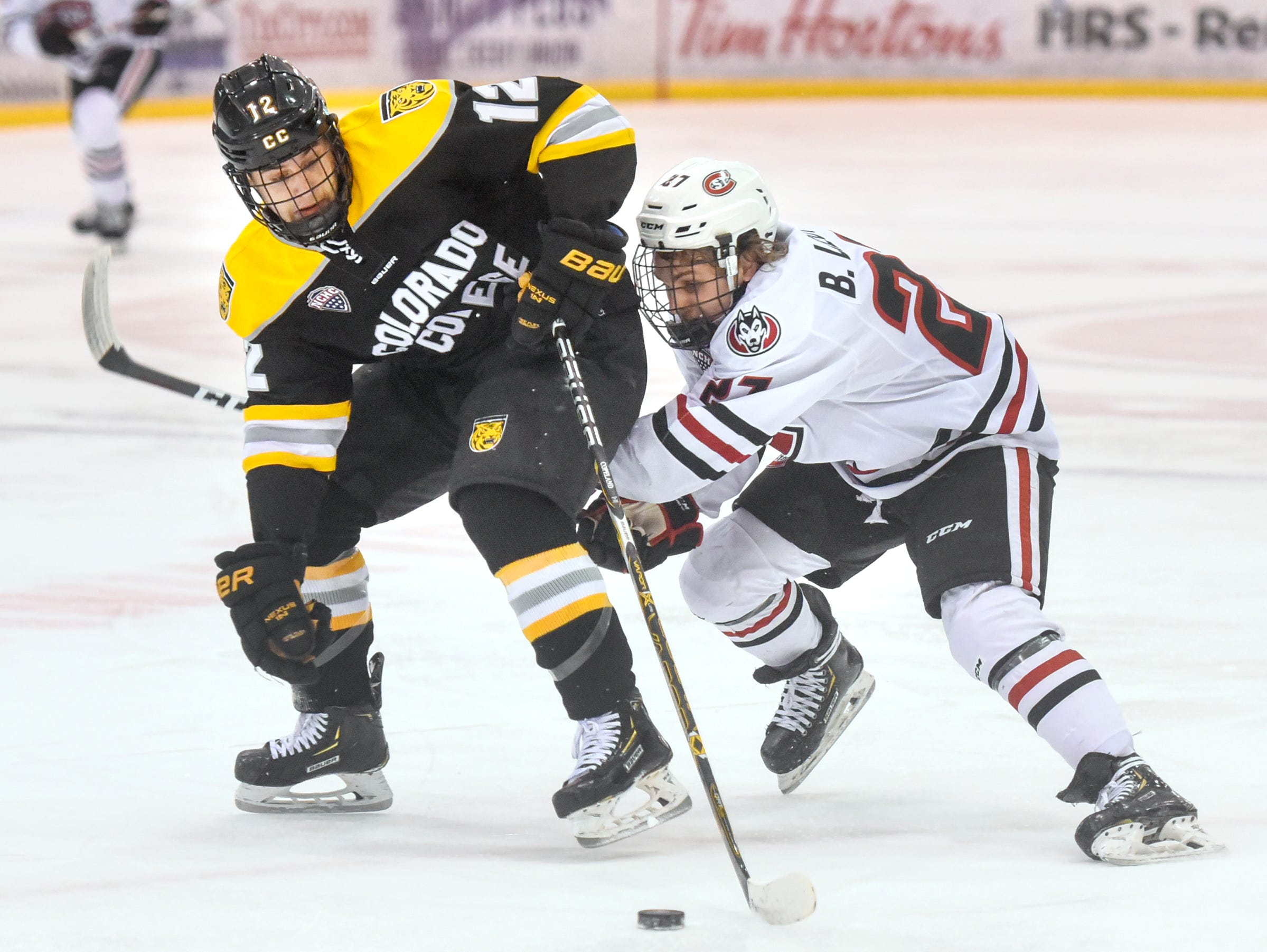 St. Cloud State's Blake Lizotte and Ben Copeland of Colorado College battle for control of the puck during the first period of the Friday, Feb. 8, game at the Herb Brooks National Hockey Center in St. Cloud.