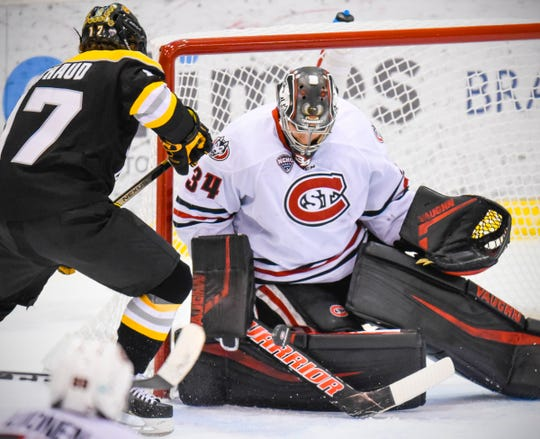 St. Cloud State goaltender David Hrenak makes a save during the first period of the Friday, Feb. 8, game at the Herb Brooks National Hockey Center in St. Cloud.