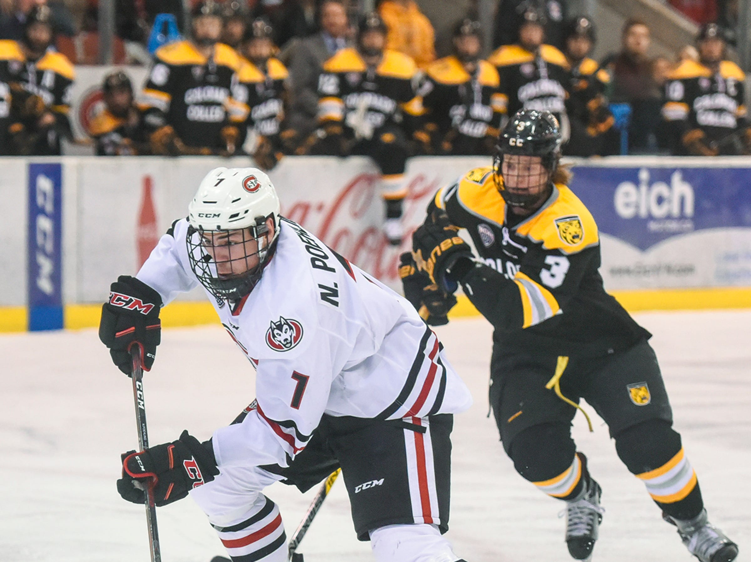 St. Cloud State's Nick Poehling gets past Kristian Blumenschlein of Colorado College during the first period of the Friday, Feb. 8, game at the Herb Brooks National Hockey Center in St. Cloud.