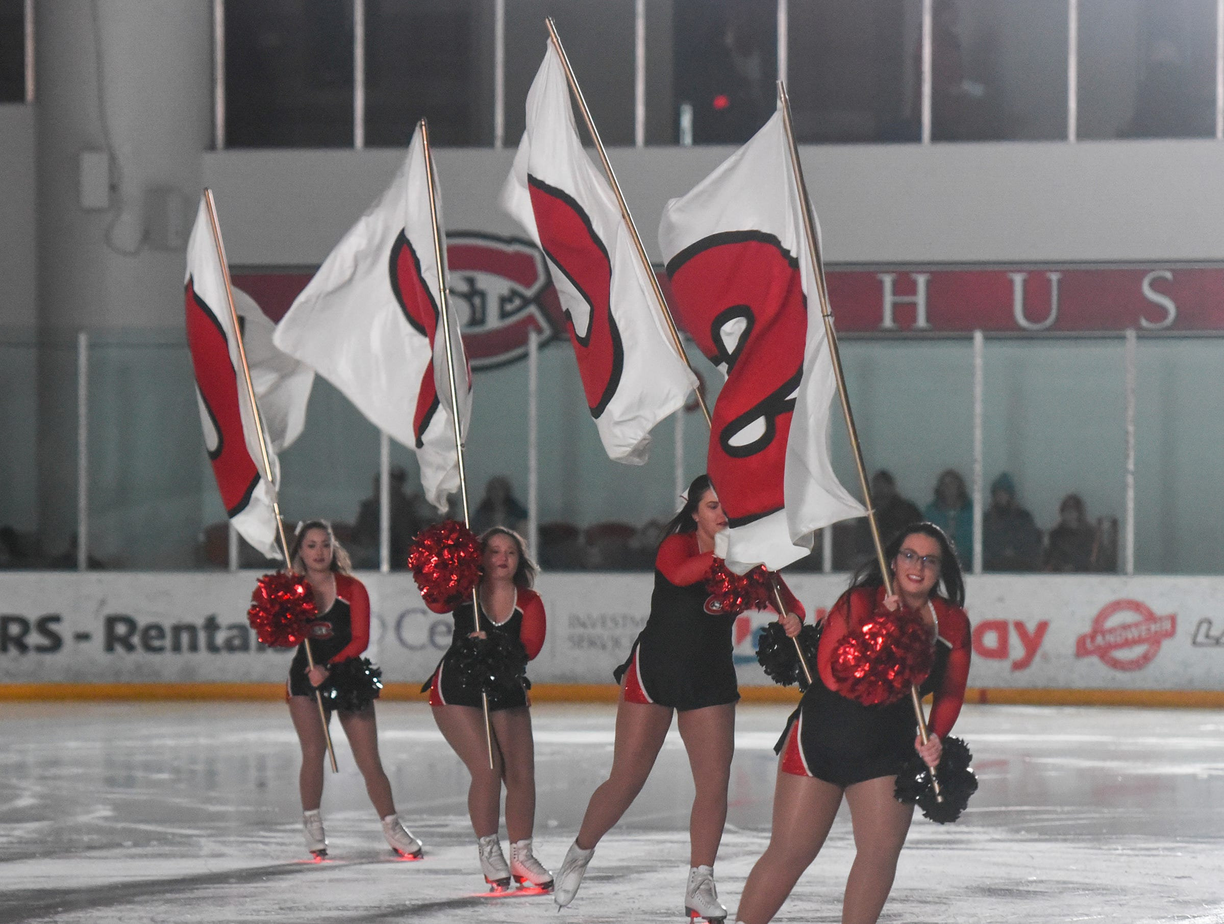 Cheerleaders for St. Cloud State take the ice before the start of the Friday, Feb. 8, game at the Herb Brooks National Hockey Center in St. Cloud.