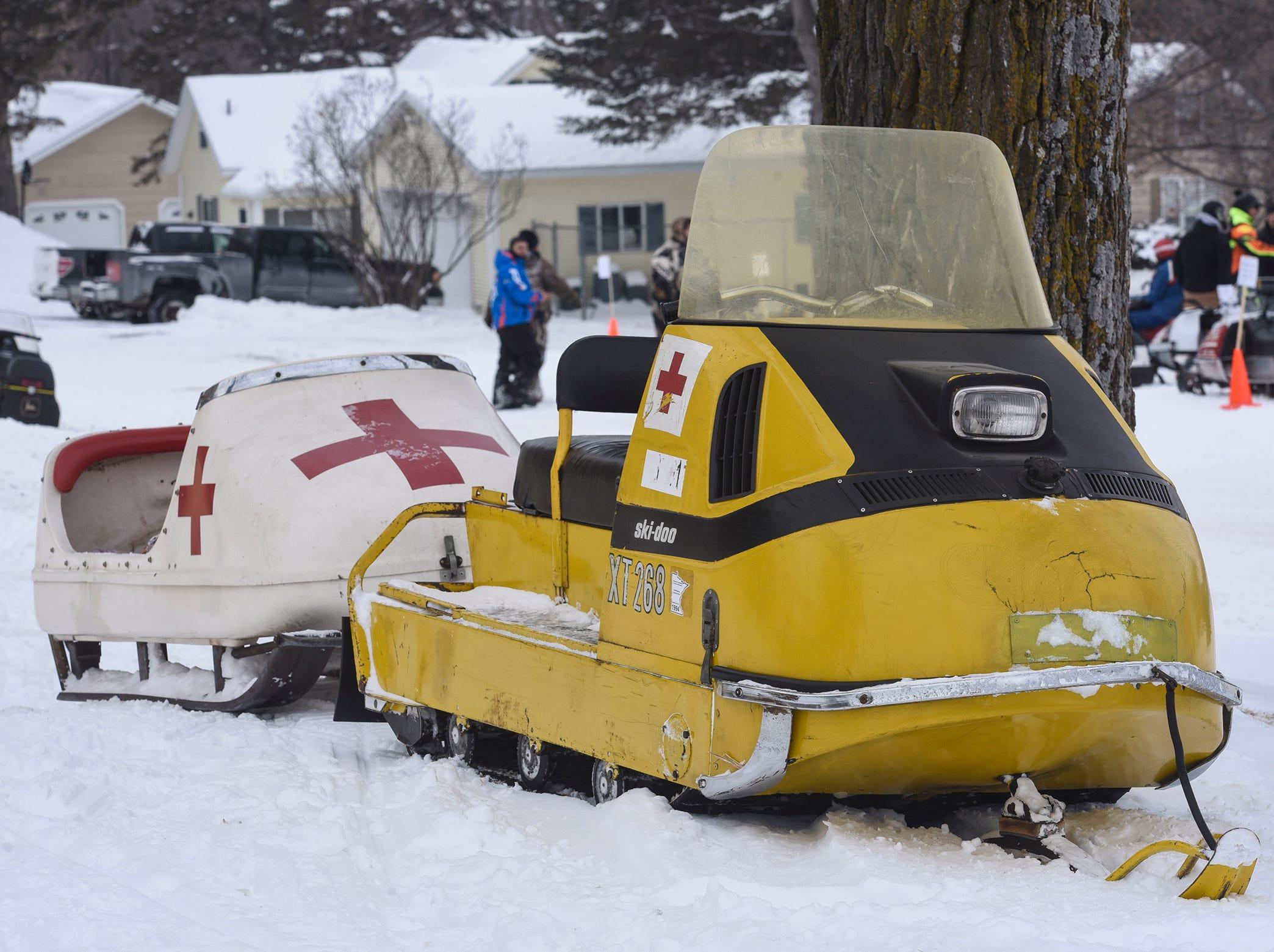 A vintage medical snowmobile is on display.
