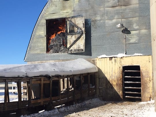 A fire burns in a hayloft in St. Joseph Township on Friday, Feb. 8.