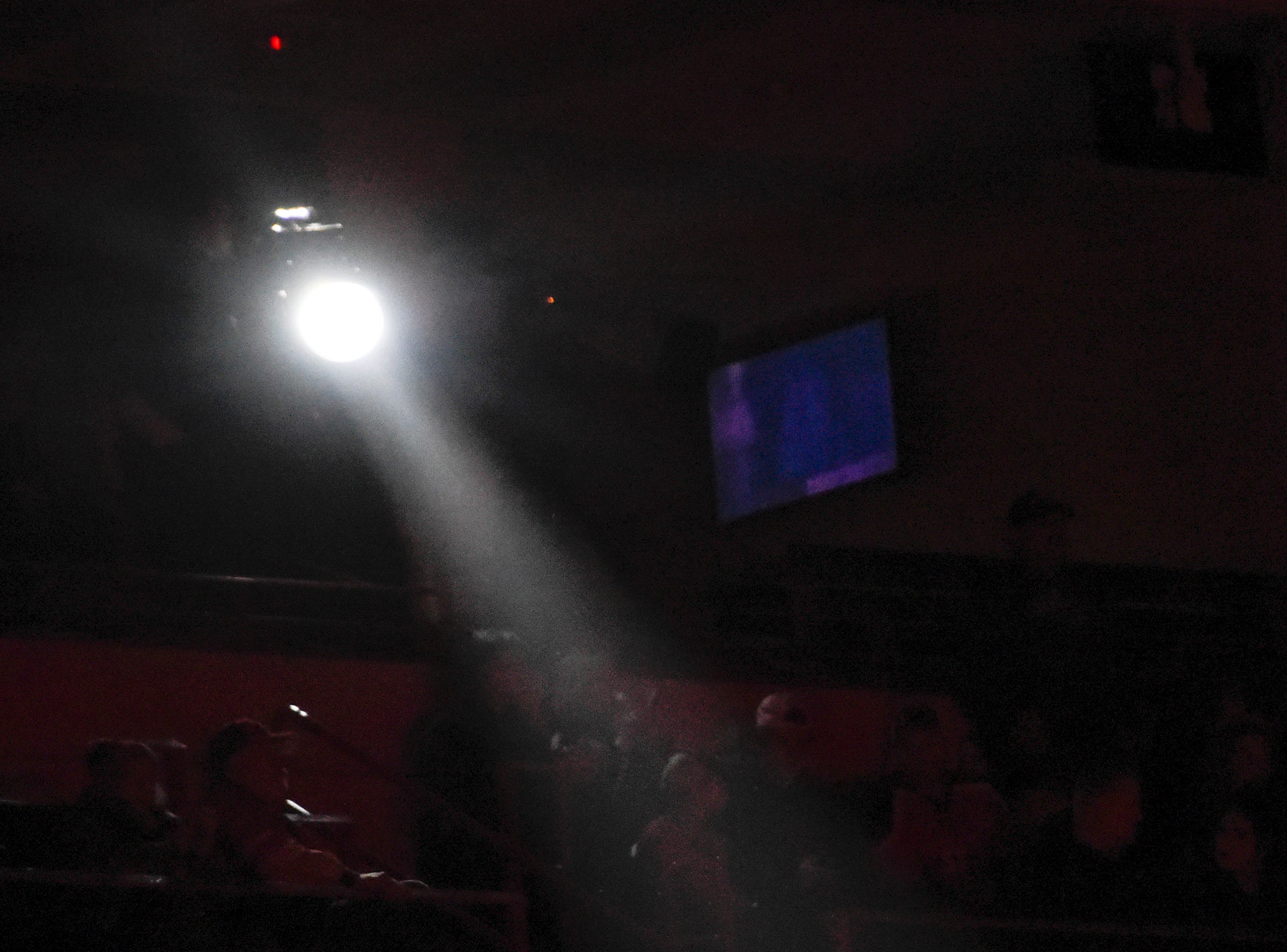 A spotlight highlights fans in the stands during introductions Friday at the Herb Brooks National Hockey Center in St. Cloud.