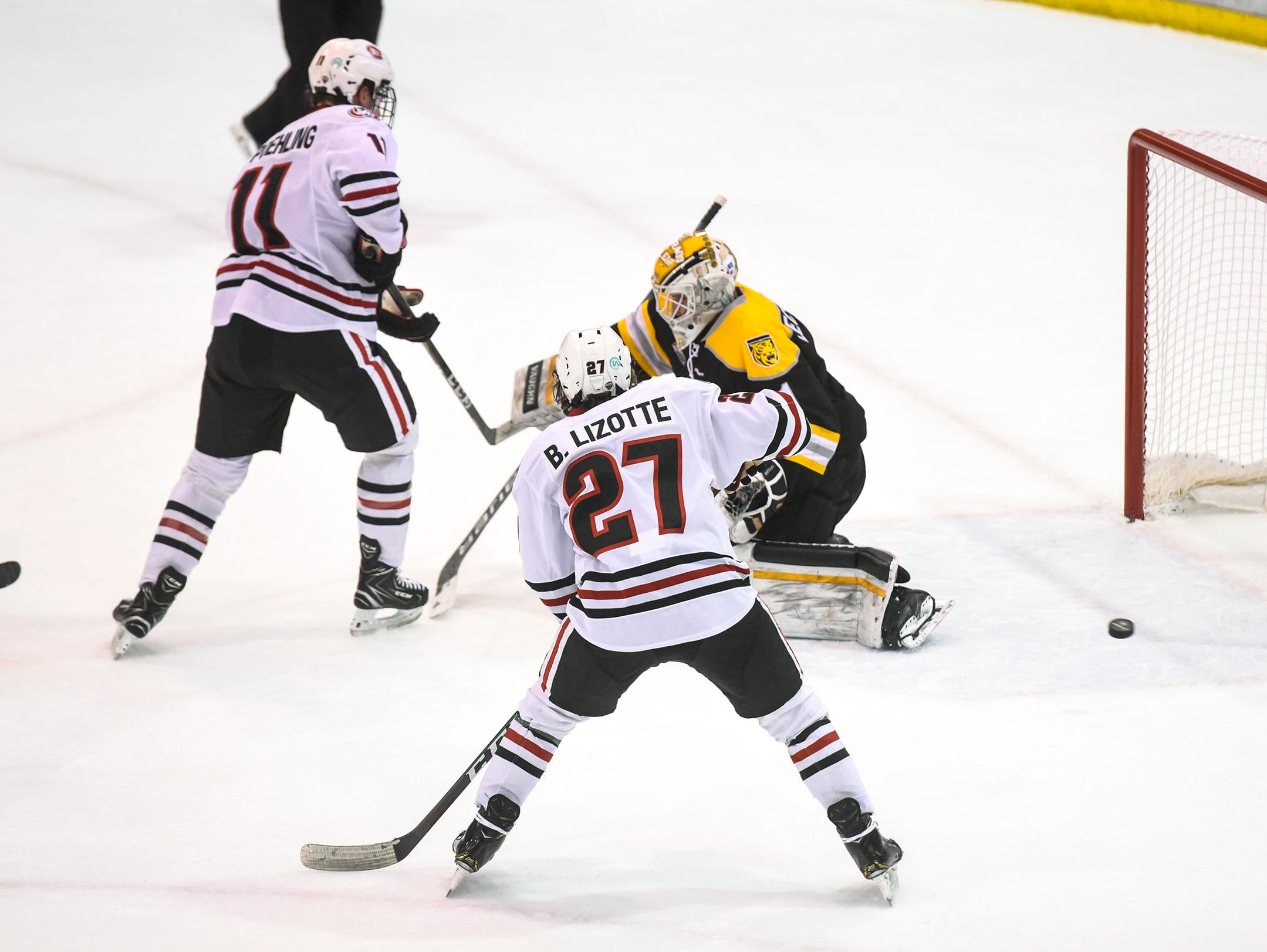 The puck skips past the Colorado College goal during the first period of the Friday, Feb. 8, game at the Herb Brooks National Hockey Center in St. Cloud.