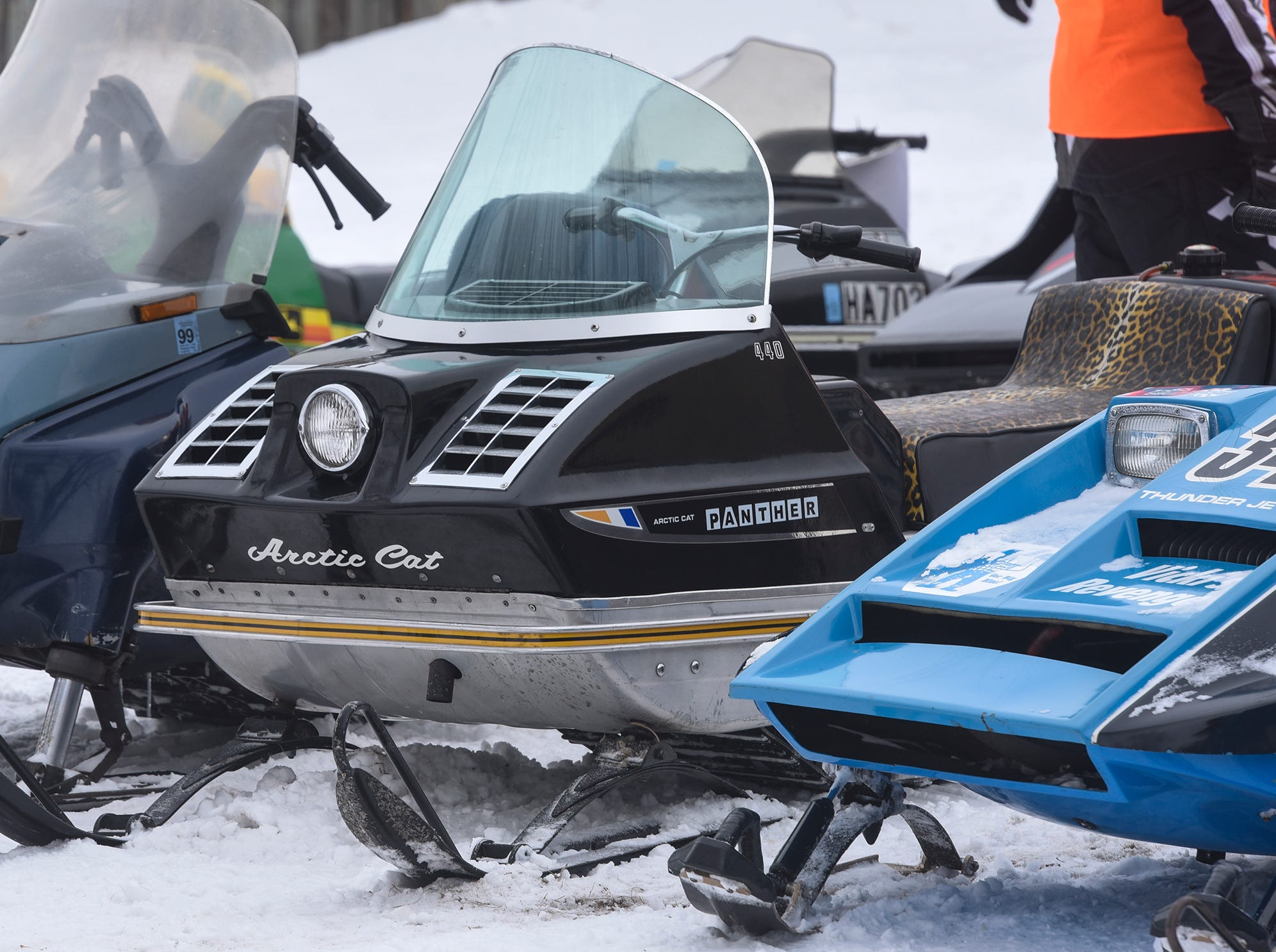 A row of vintage snowmobiles is on display Saturday in St. Stephen .