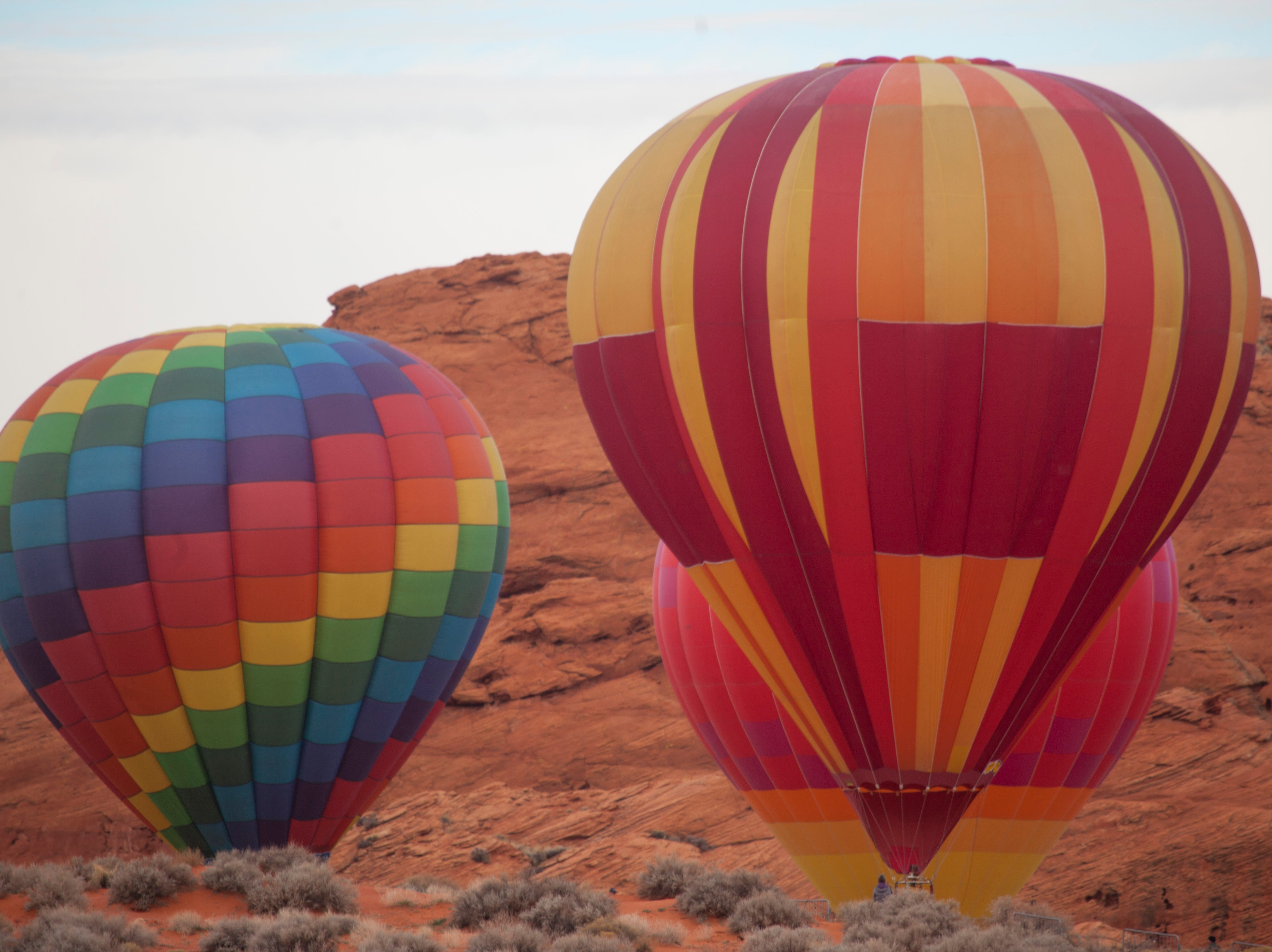 Hot air balloon fans gather at the Sand Hollow Golf Course for the annual balloon festival Saturday, Feb. 9, 2019.