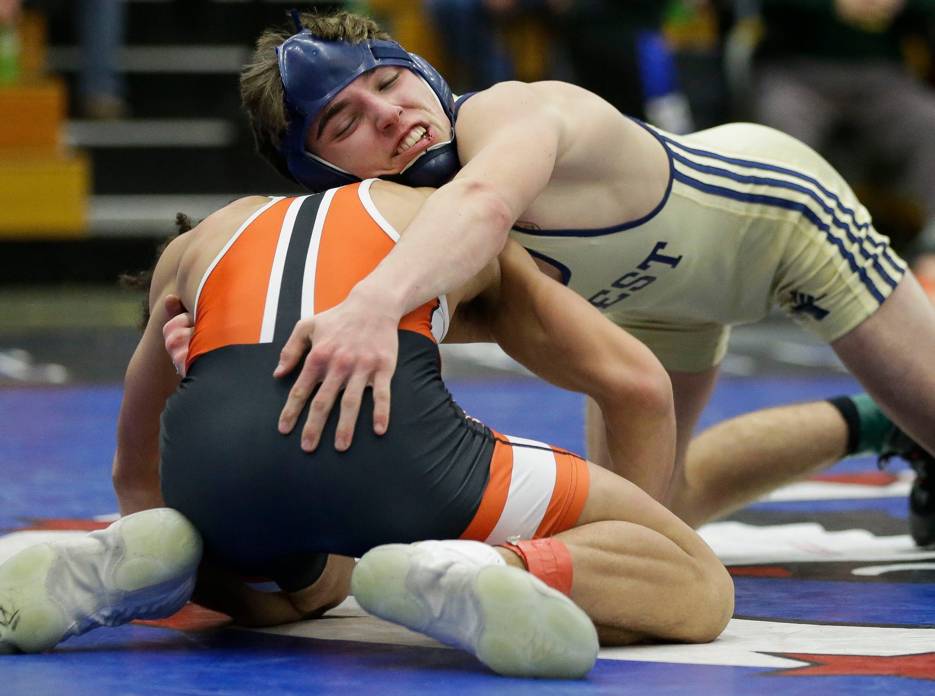 Wausau West's Cameron Schmeiser wrestles against Marshfield's Gabe Pugh in the 126-pound championship match on Saturday, February 9, 2019, during a regional tournament at Merrill High School in Merrill, Wis.