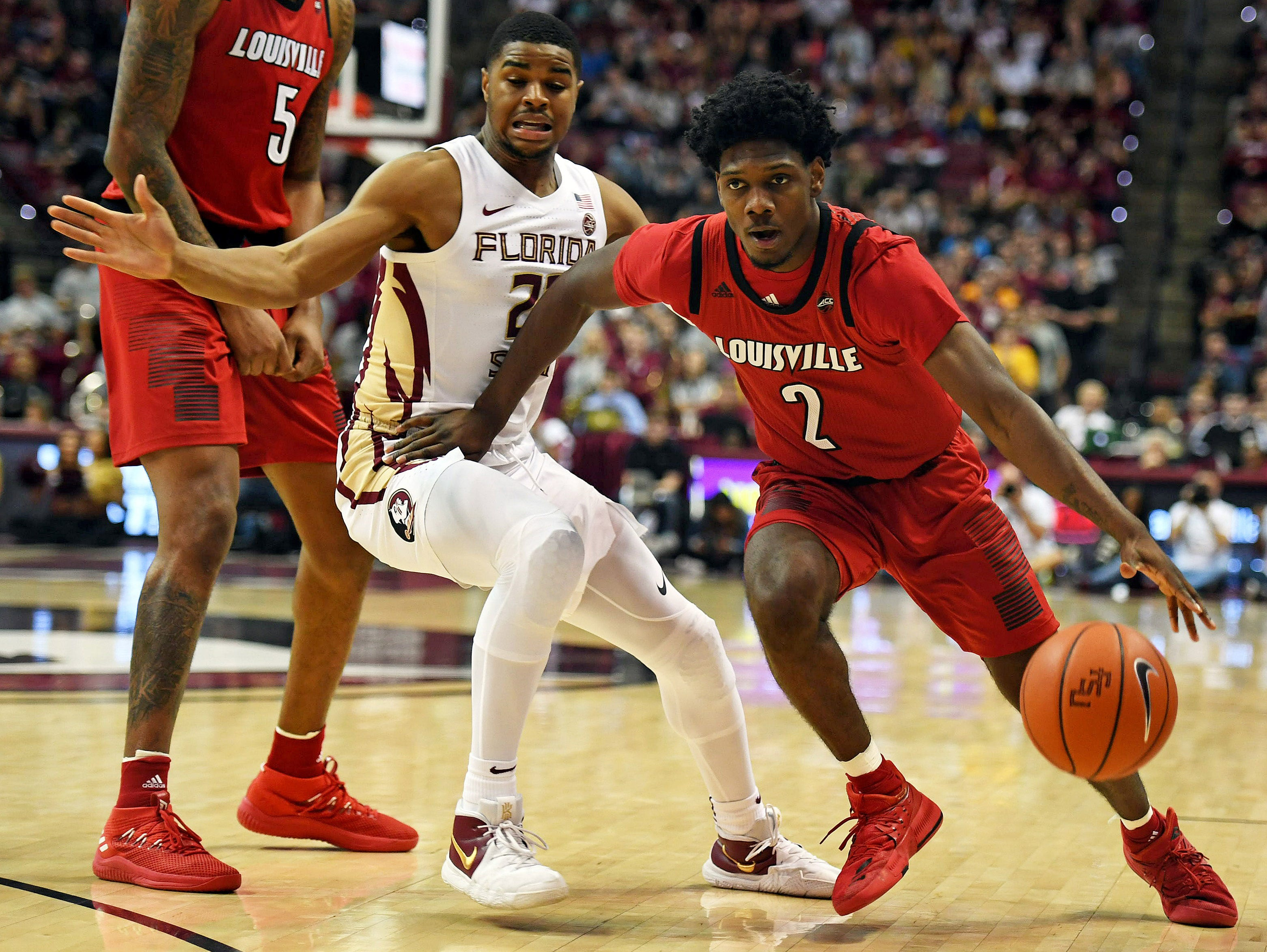 Feb 9, 2019; Tallahassee, FL, USA; Louisville Cardinals guard Darius Perry (2) drives the ball against Florida State Seminoles guard MJ Walker (23) during the first half at Donald L. Tucker Center. Mandatory Credit: Melina Myers-USA TODAY Sports
