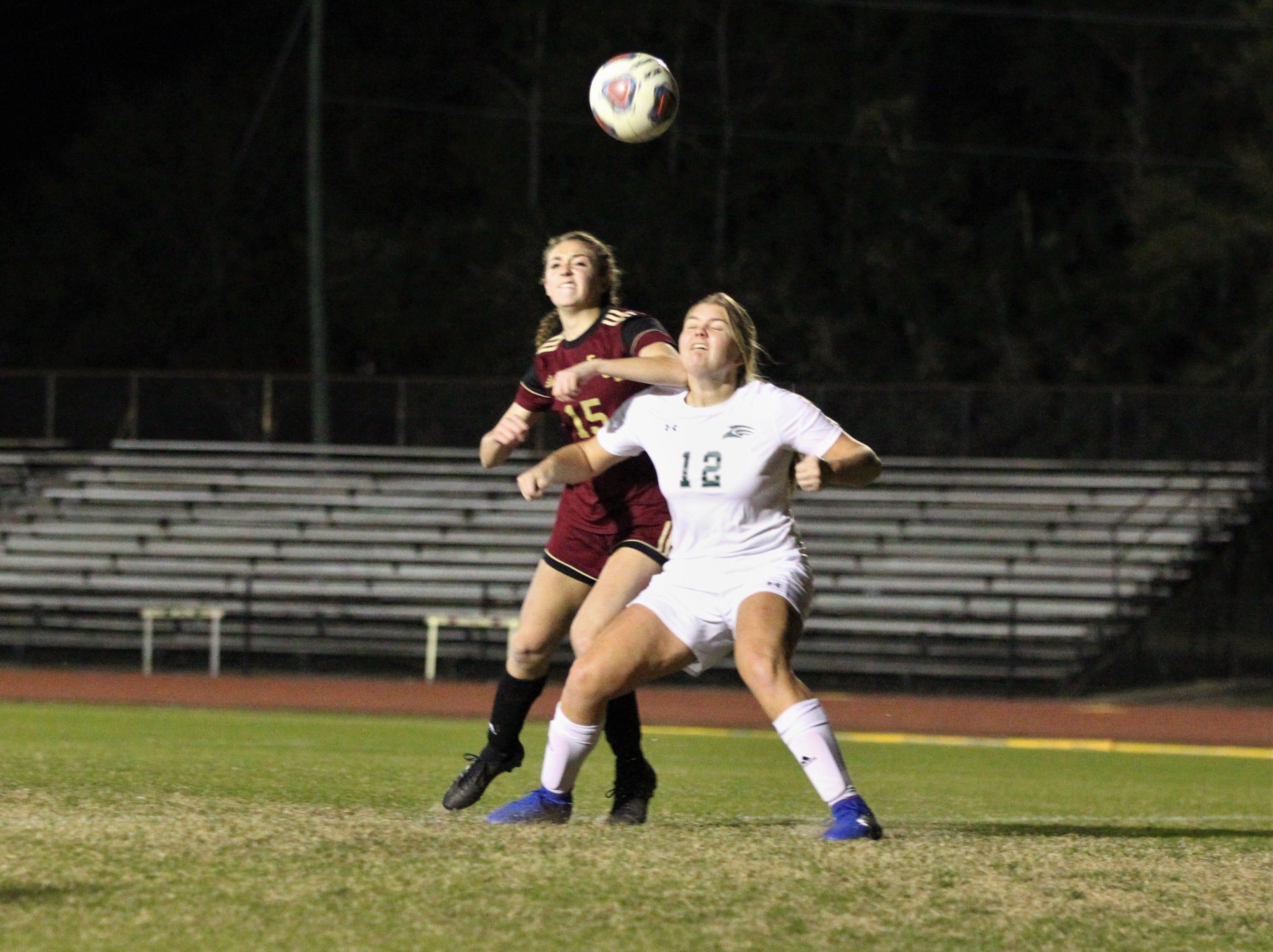 Florida High's Lauren Kreis battles to win an air ball in the box as South Walton edged the Seminoles 5-4 in a penalty-kick shootout during a Region 1-2A semifinal on Feb. 8, 2019.