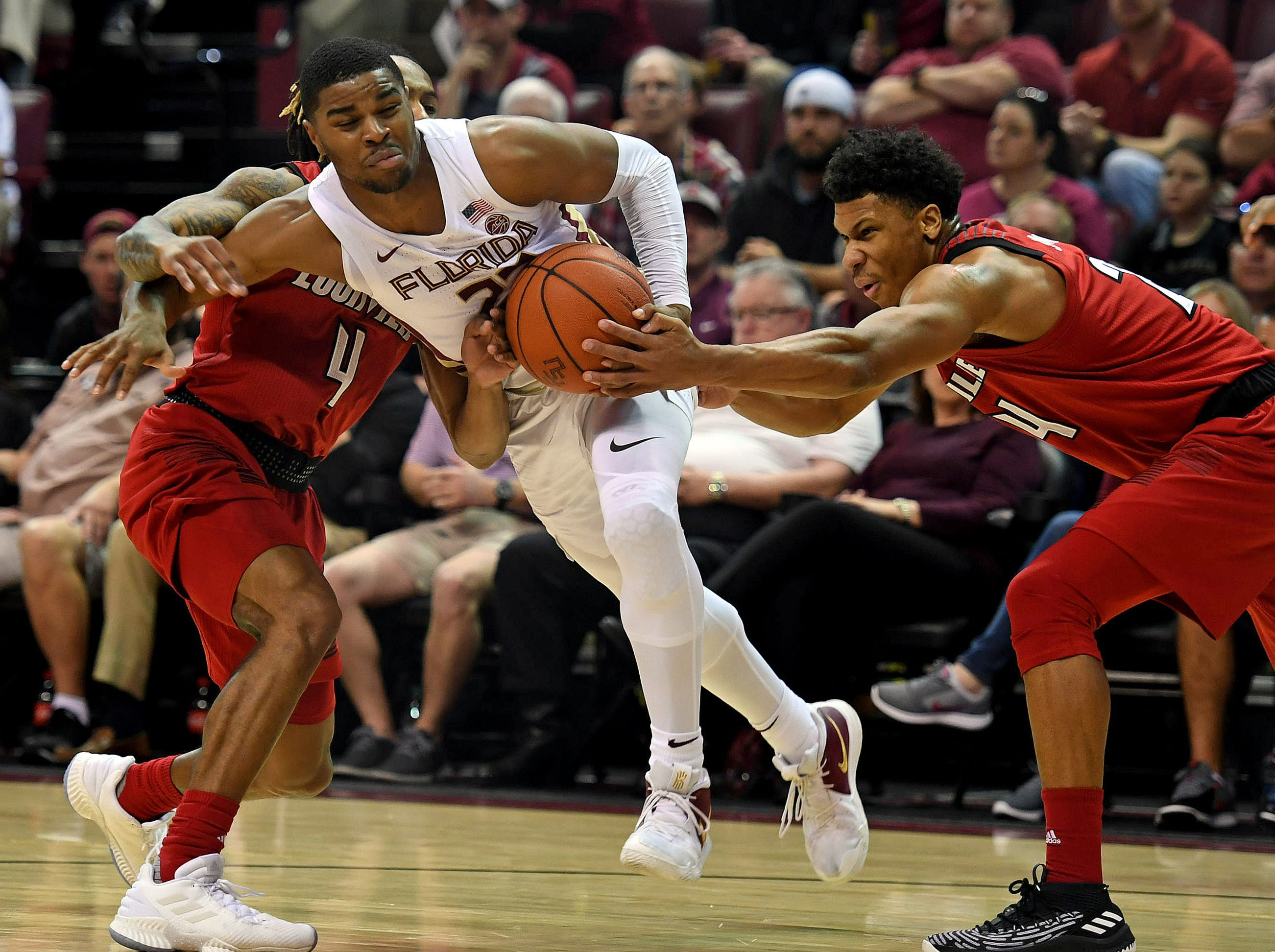 Feb 9, 2019; Tallahassee, FL, USA; Louisville Cardinals forward Dwayne Sutton (24) fights for a ball against Florida State Seminoles guard MJ Walker (23) during the first half at Donald L. Tucker Center. Mandatory Credit: Melina Myers-USA TODAY Sports