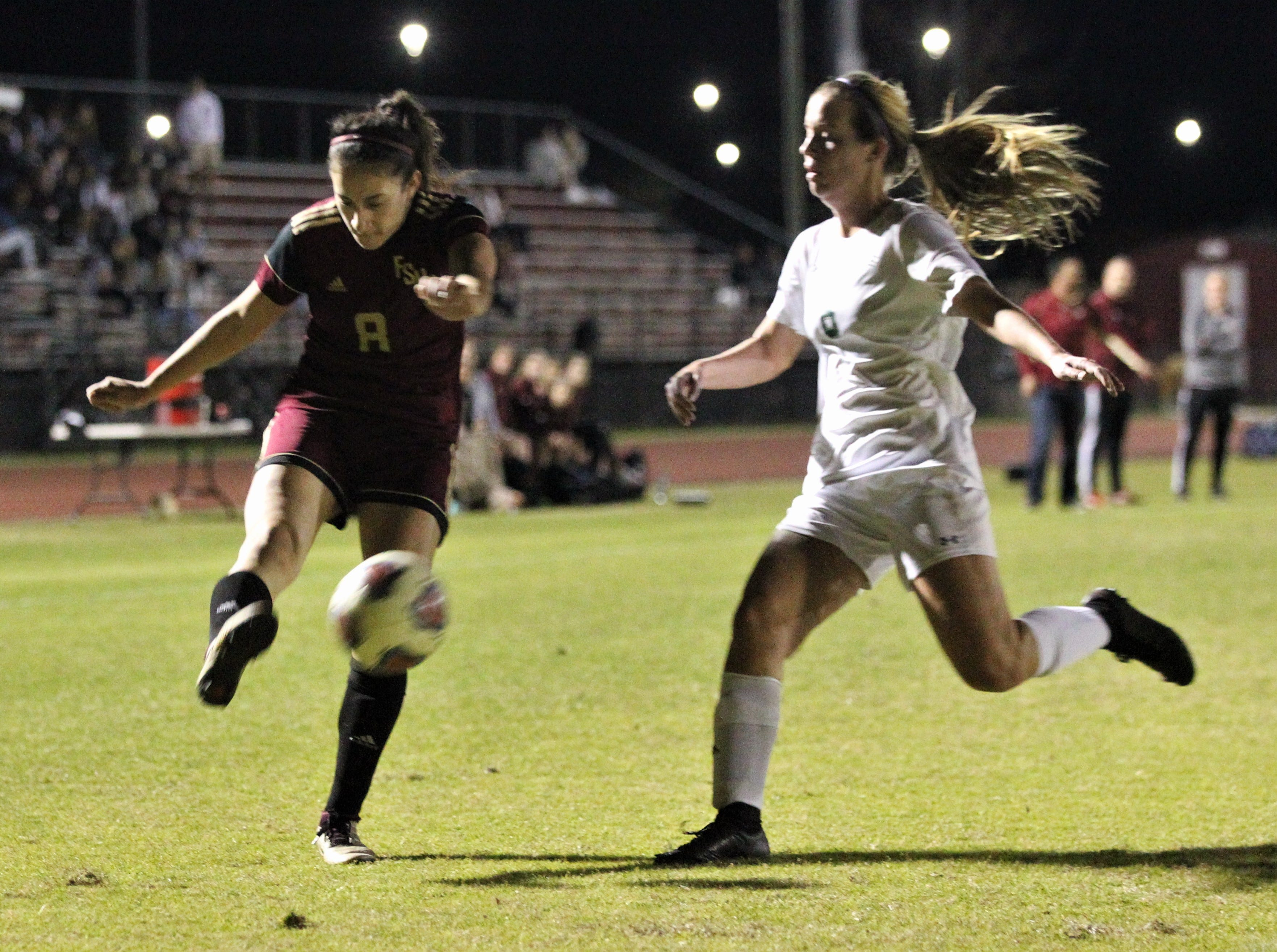 Florida High's Lily Quijada sends a cross as South Walton edged the Seminoles 5-4 in a penalty-kick shootout during a Region 1-2A semifinal on Feb. 8, 2019.