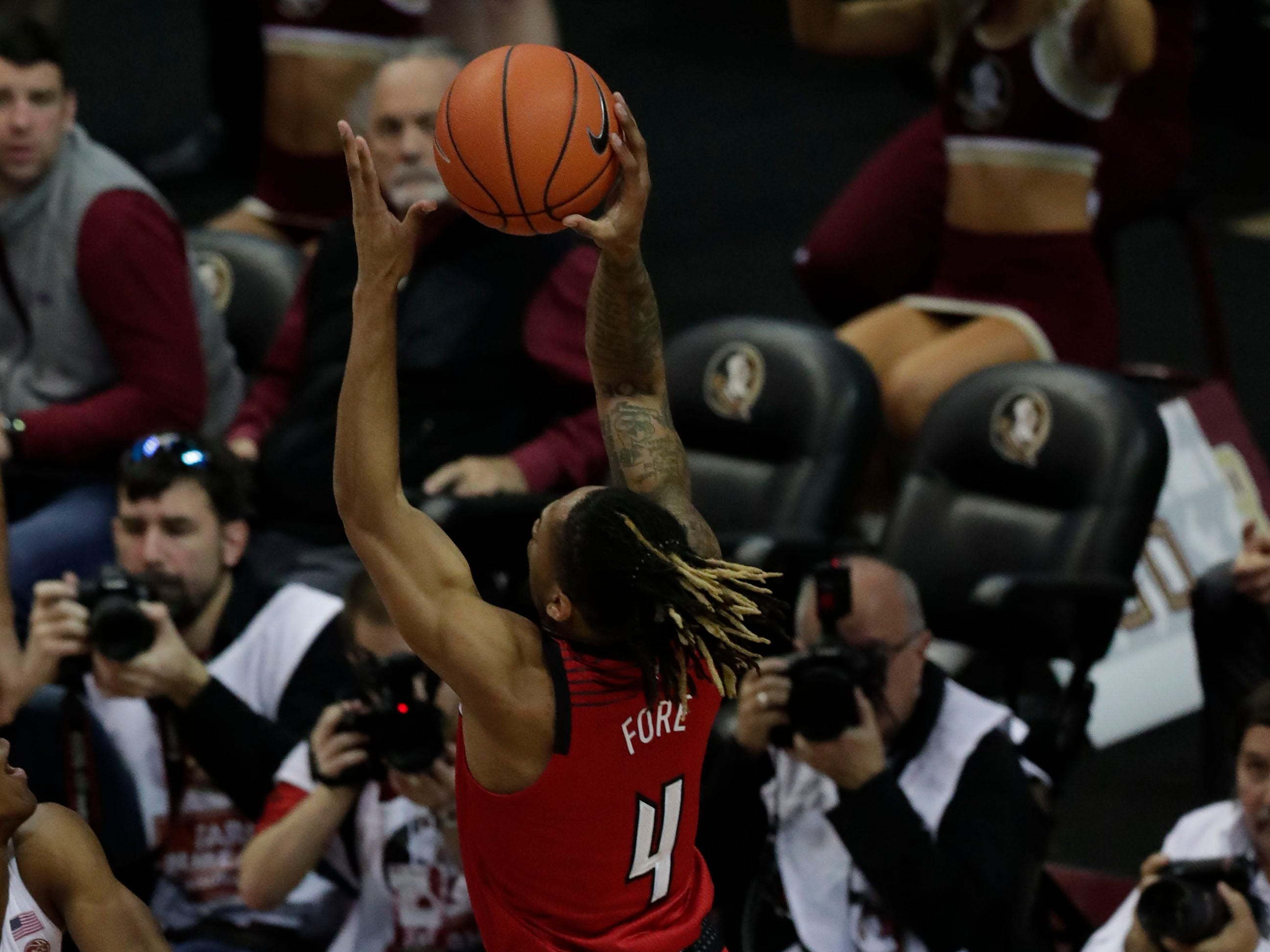 Florida State Seminoles guard Ty Hands (4) shoots from inside the paint as the Florida State Seminoles host the Louisville Cardinals at the Tucker Civic Center, Saturday Feb. 9, 2019.