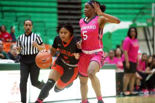 FAMU's Candice Williams drives by Ayonna Williams of Howard. She scored 11 points in an 81-59 loss on Saturday, Feb. 9 2019 at the Al Lawson Multipurpose Center.