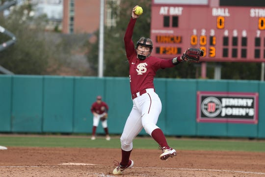 Florida State Seminoles pitcher Kathryn Sandercock (32) pitches to a batter as the Florida State Seminoles take on the UNC Wilmington Seahawks in their first game of the season at the Joanne Graf Stadium, Friday Feb. 8, 2019.
