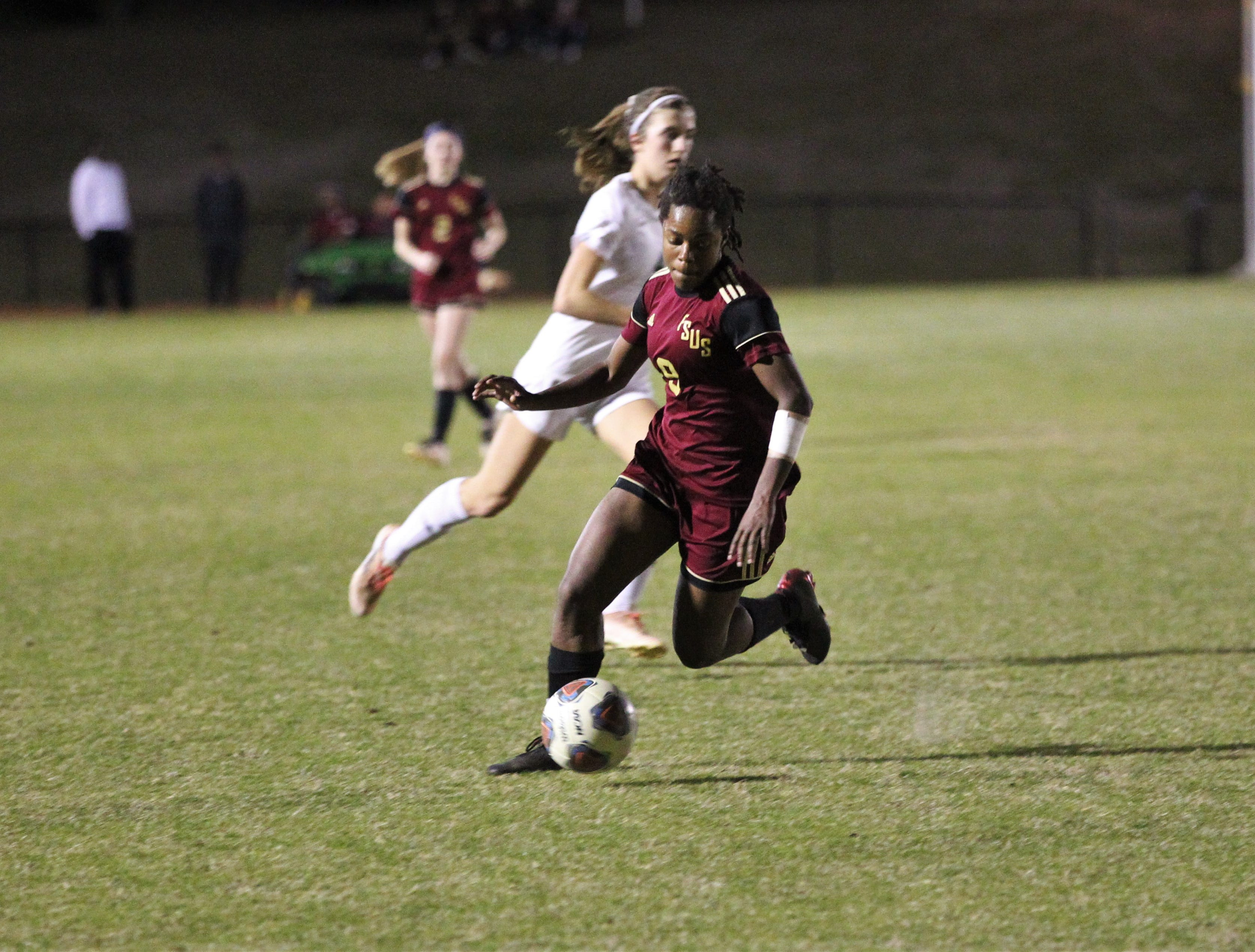 Florida High's Janae Scott dribbles in hte offensive third as South Walton edged the Seminoles 5-4 in a penalty-kick shootout during a Region 1-2A semifinal on Feb. 8, 2019.