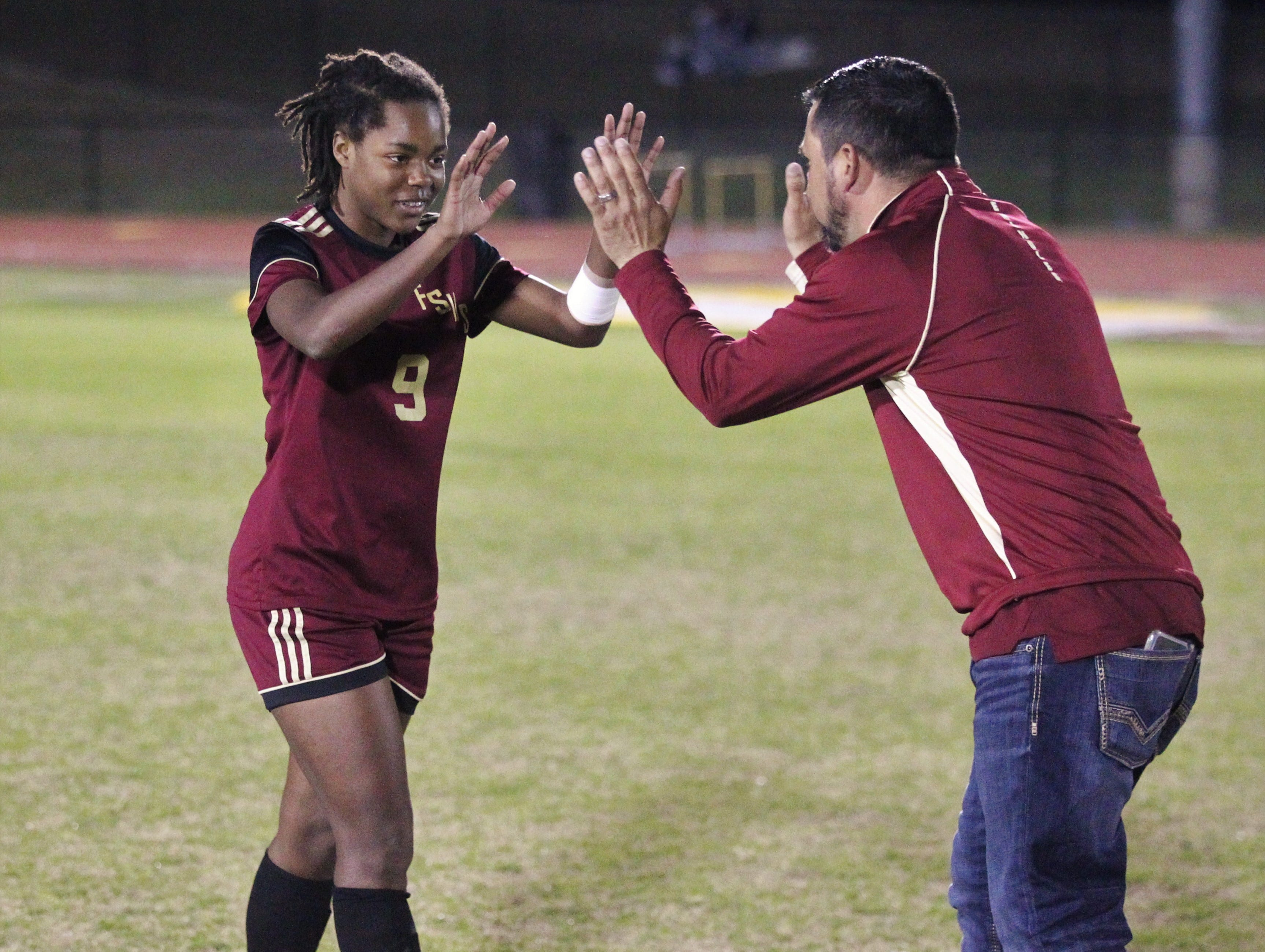 Florida High's Janae Scott is greeted by a coach after making a PK as South Walton's girls soccer team edged the Seminoles 5-4 in a penalty-kick shootout during a Region 1-2A semifinal on Feb. 8, 2019.