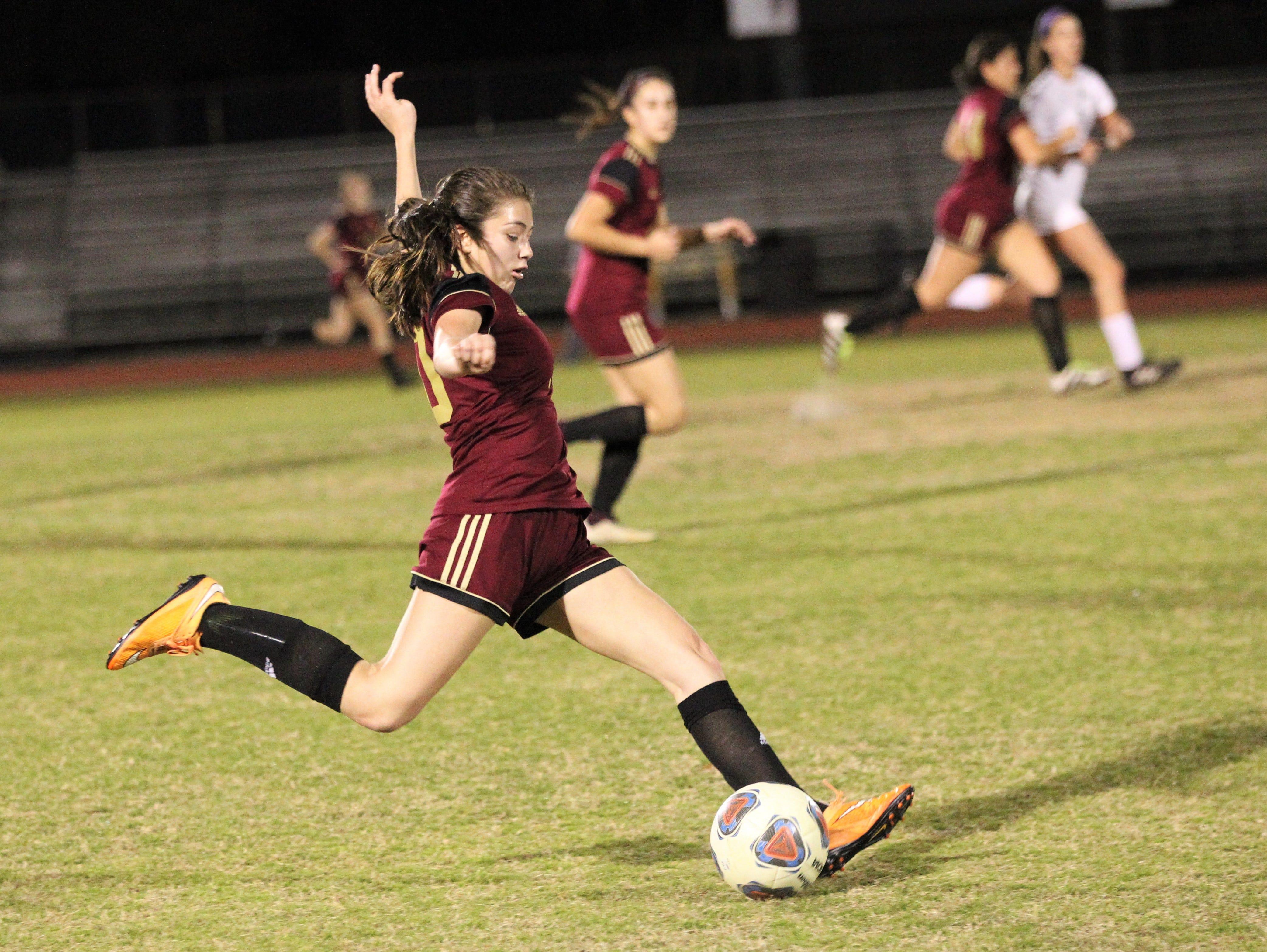 Florida High's Adriana Limburg passes ahead as South Walton's girls soccer team edged the Seminoles 5-4 in a penalty-kick shootout during a Region 1-2A semifinal on Feb. 8, 2019.