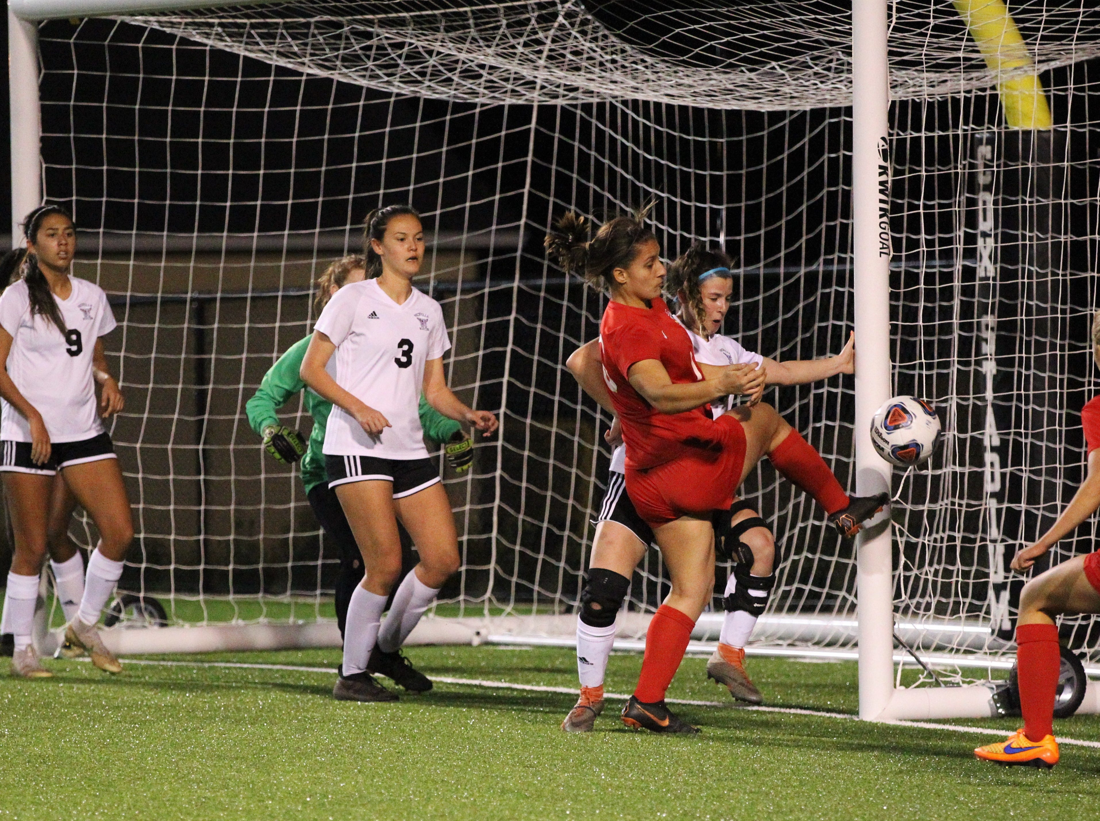 A Leon corner kick can't be cleared by Niceville, providing an opportunity for Eden Kirn (16) at goal but a Niceville defender provides just enough of a block as Niceville's girls soccer team beat Leon 1-0 in a Region 1-4A semifinal at Gene Cox Stadium on Jan. 8, 2019.