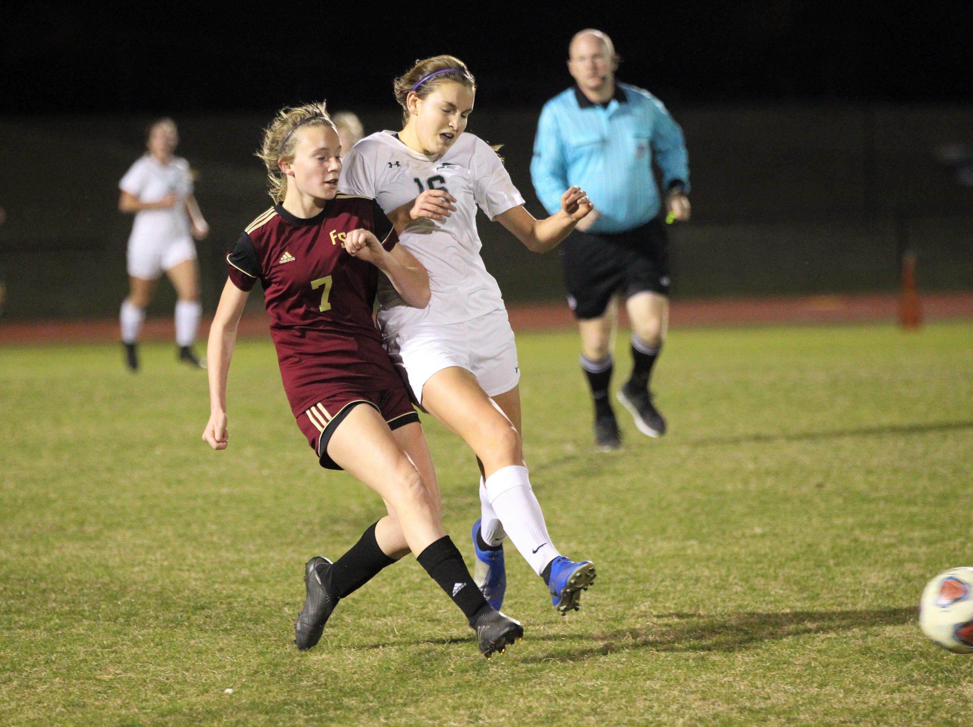Florida High's Ava Dubois passes ahead under pressure as South Walton's girls soccer team edged the Seminoles 5-4 in a penalty-kick shootout during a Region 1-2A semifinal on Feb. 8, 2019.