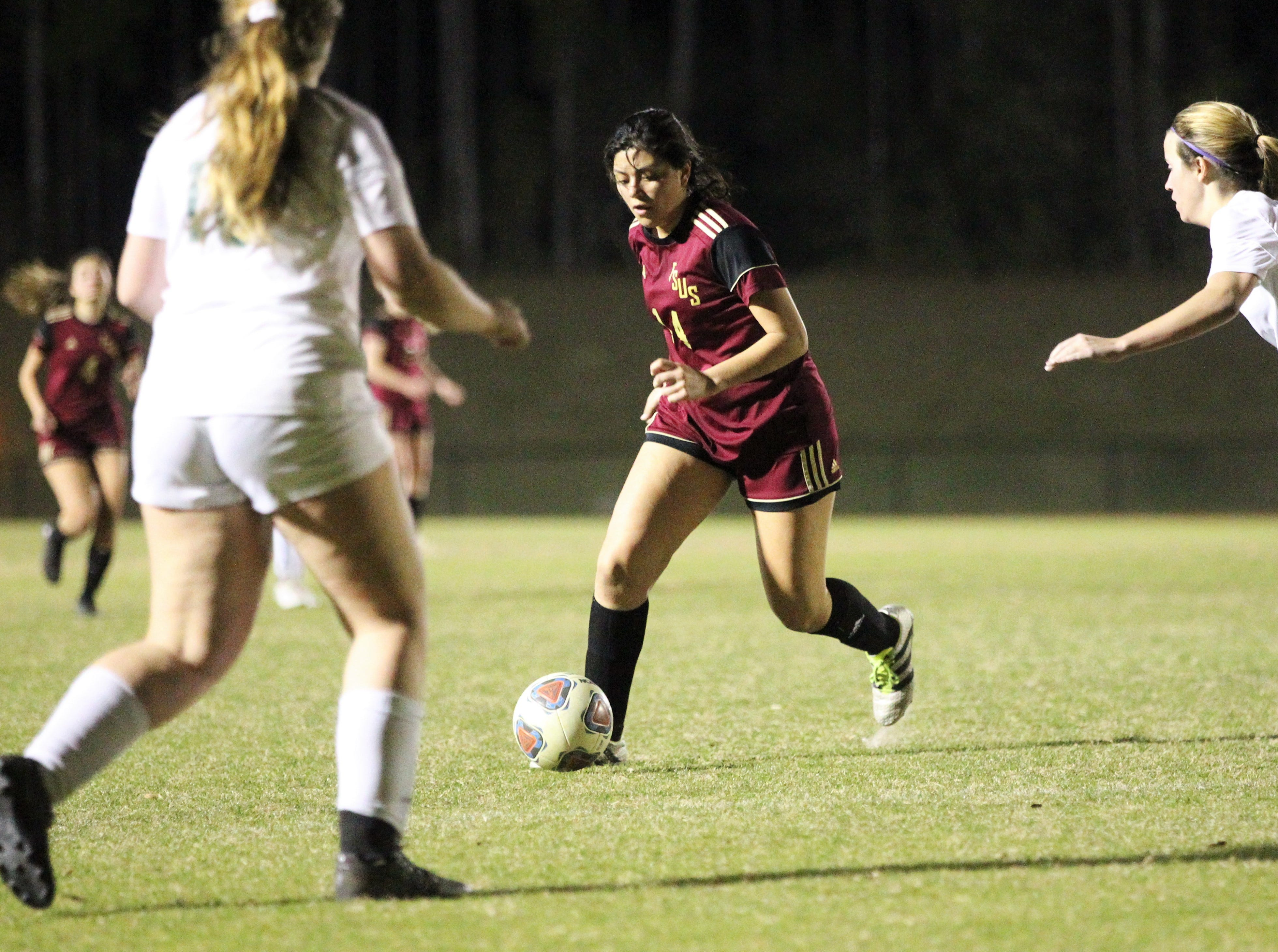 Florida High's Rubi Castro dribbles at the top of the box as South Walton's girls soccer team edged the Seminoles 5-4 in a penalty-kick shootout during a Region 1-2A semifinal on Feb. 8, 2019.