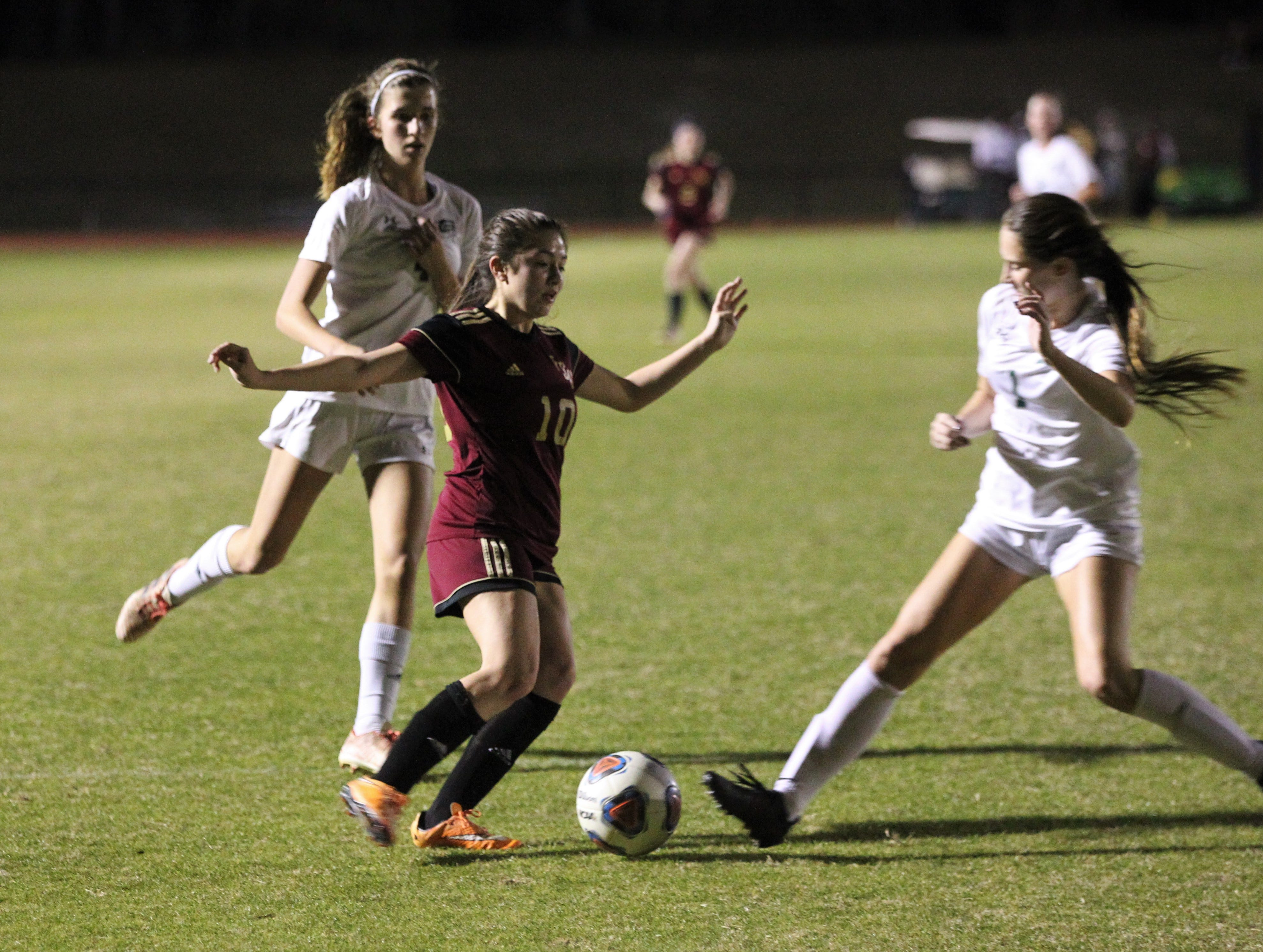 Florida High's Adriana Limburg tries to dribble past a defender as South Walton edged the Seminoles 5-4 in a penalty-kick shootout during a Region 1-2A semifinal on Feb. 8, 2019.