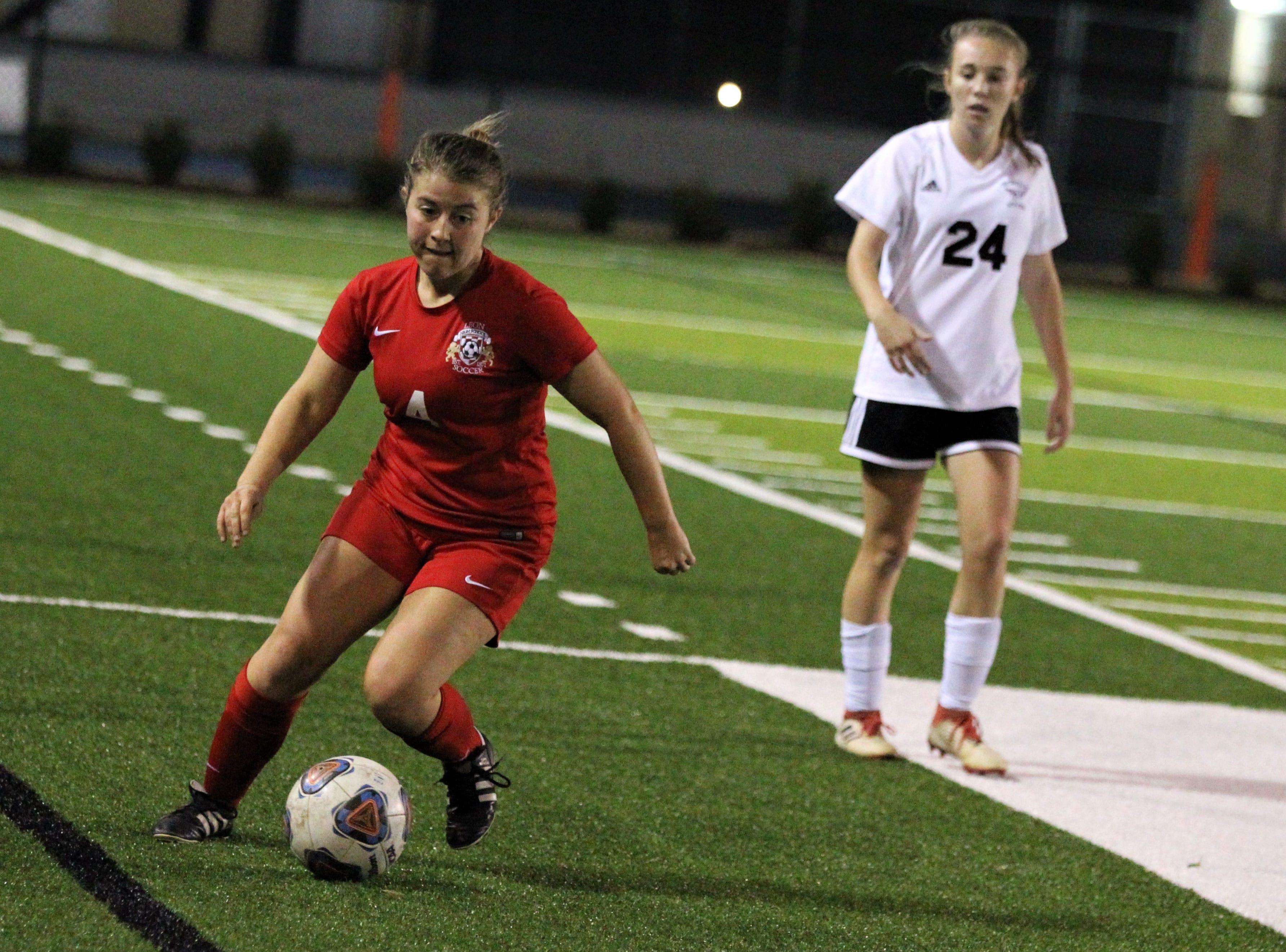 Leon's Callie Albrigo turns upfield as Niceville's girls soccer team beat Leon 1-0 in a Region 1-4A semifinal at Gene Cox Stadium on Jan. 8, 2019.