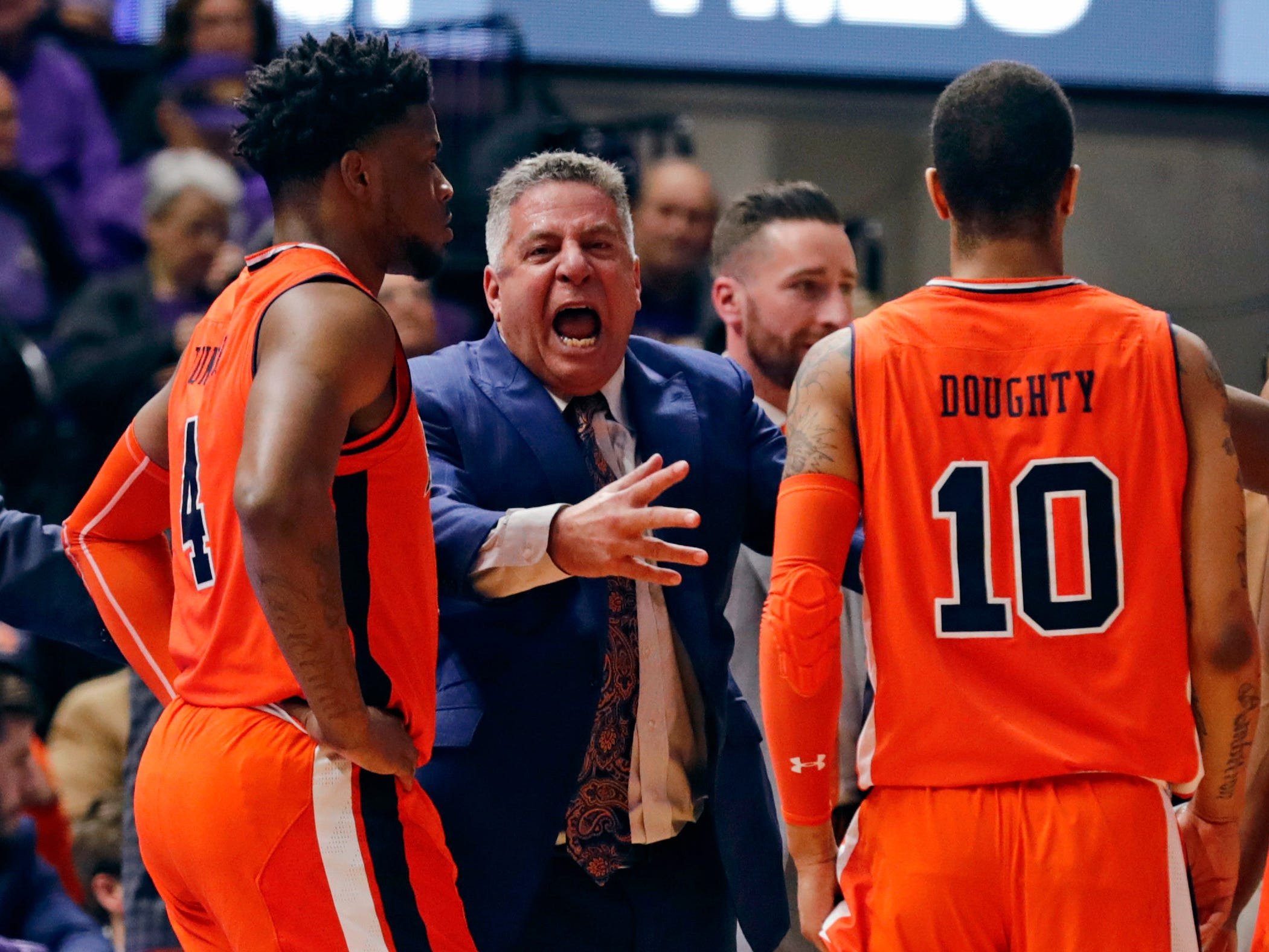 Auburn head coach Bruce Pearl talkis to players Malik Dunbar (left), Samir Doughty (center) and Anfernee McLemore (right) during a loss at LSU on Feb. 9, 2019, in Baton Rouge, La.