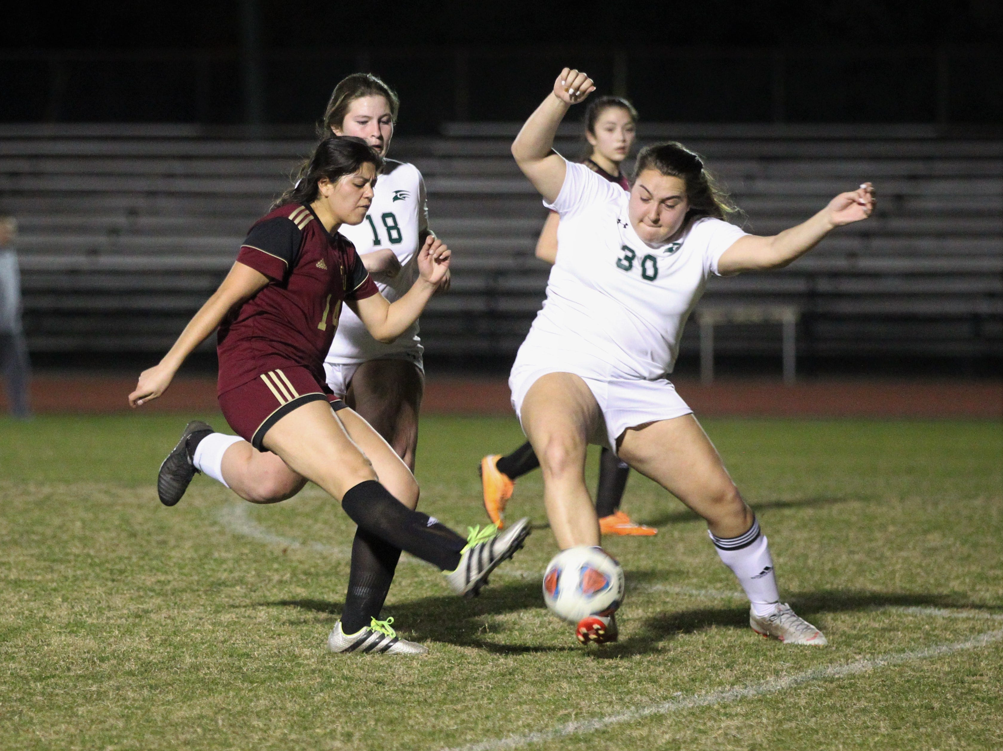 Florida High's Rubi Castro takes a shot that is disrupted as South Walton's girls soccer team edged the Seminoles 5-4 in a penalty-kick shootout during a Region 1-2A semifinal on Feb. 8, 2019.