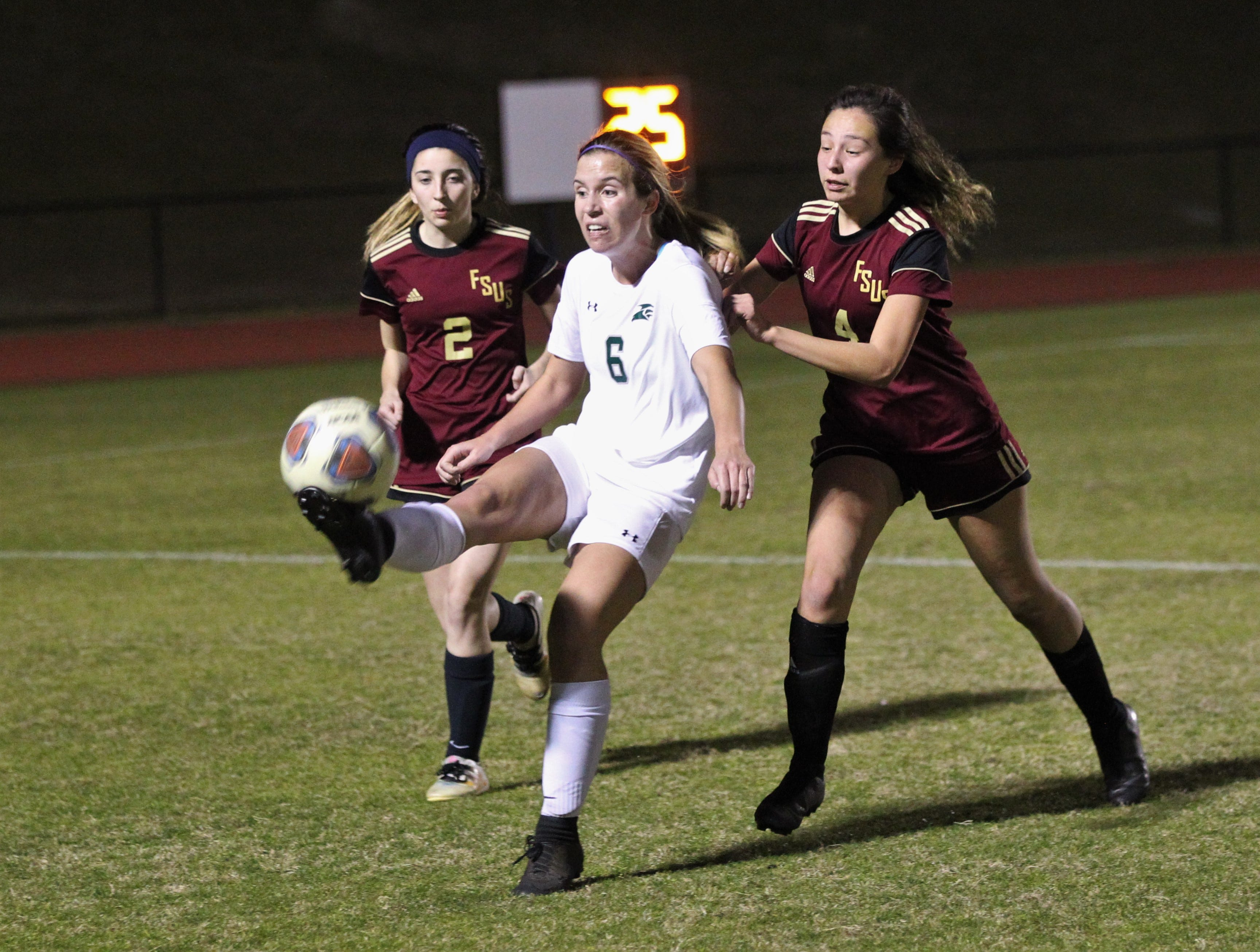 Florida High's Grace McDaniel and Daphne Cervantes defend as South Walton's girls soccer team edged the Seminoles 5-4 in a penalty-kick shootout during a Region 1-2A semifinal on Feb. 8, 2019.