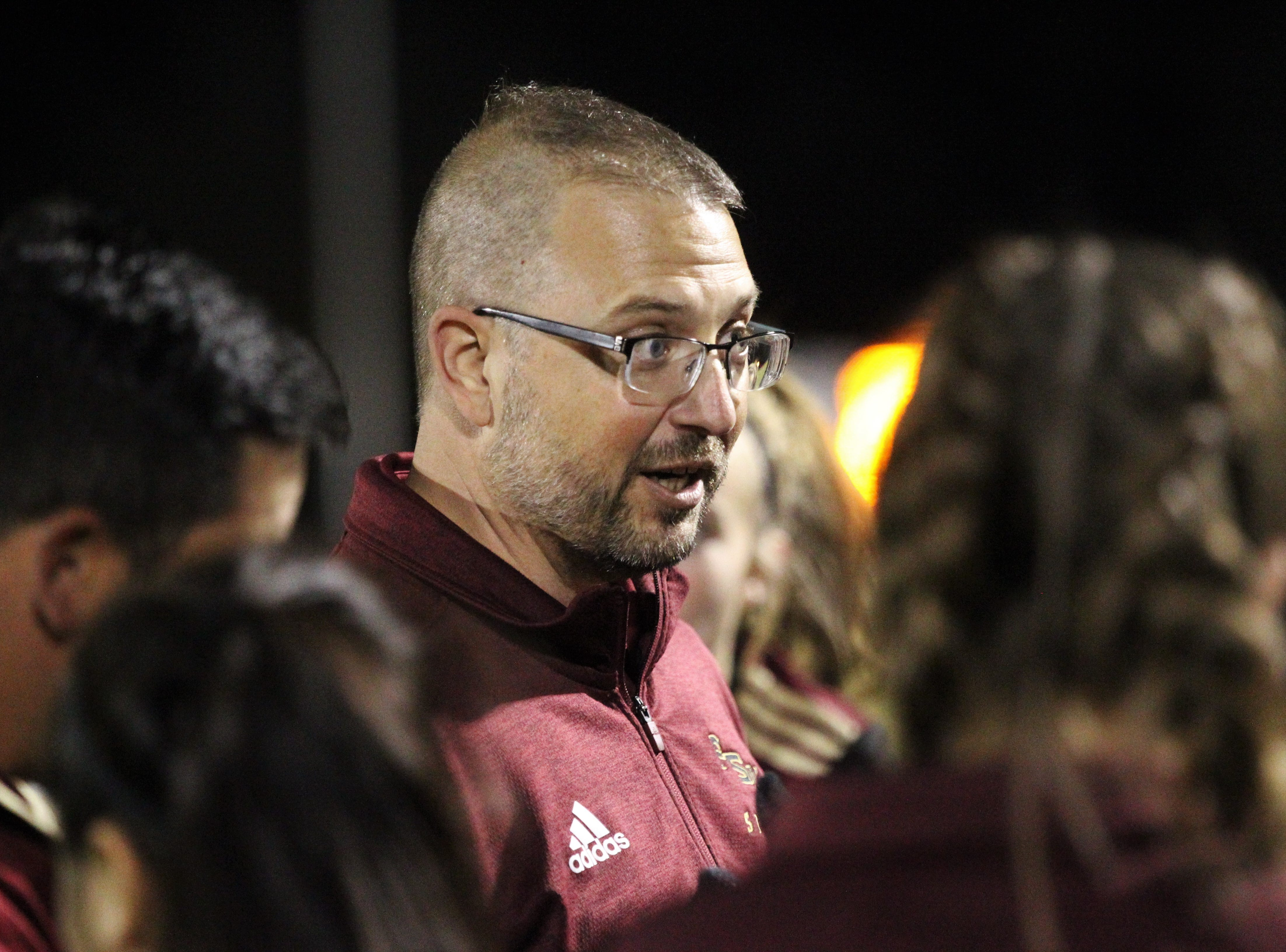 Florida High girls soccer coach Joe Szorcsik talks to his team at the end of regulation as South Walton edged the Seminoles 5-4 in a penalty-kick shootout during a Region 1-2A semifinal on Feb. 8, 2019.