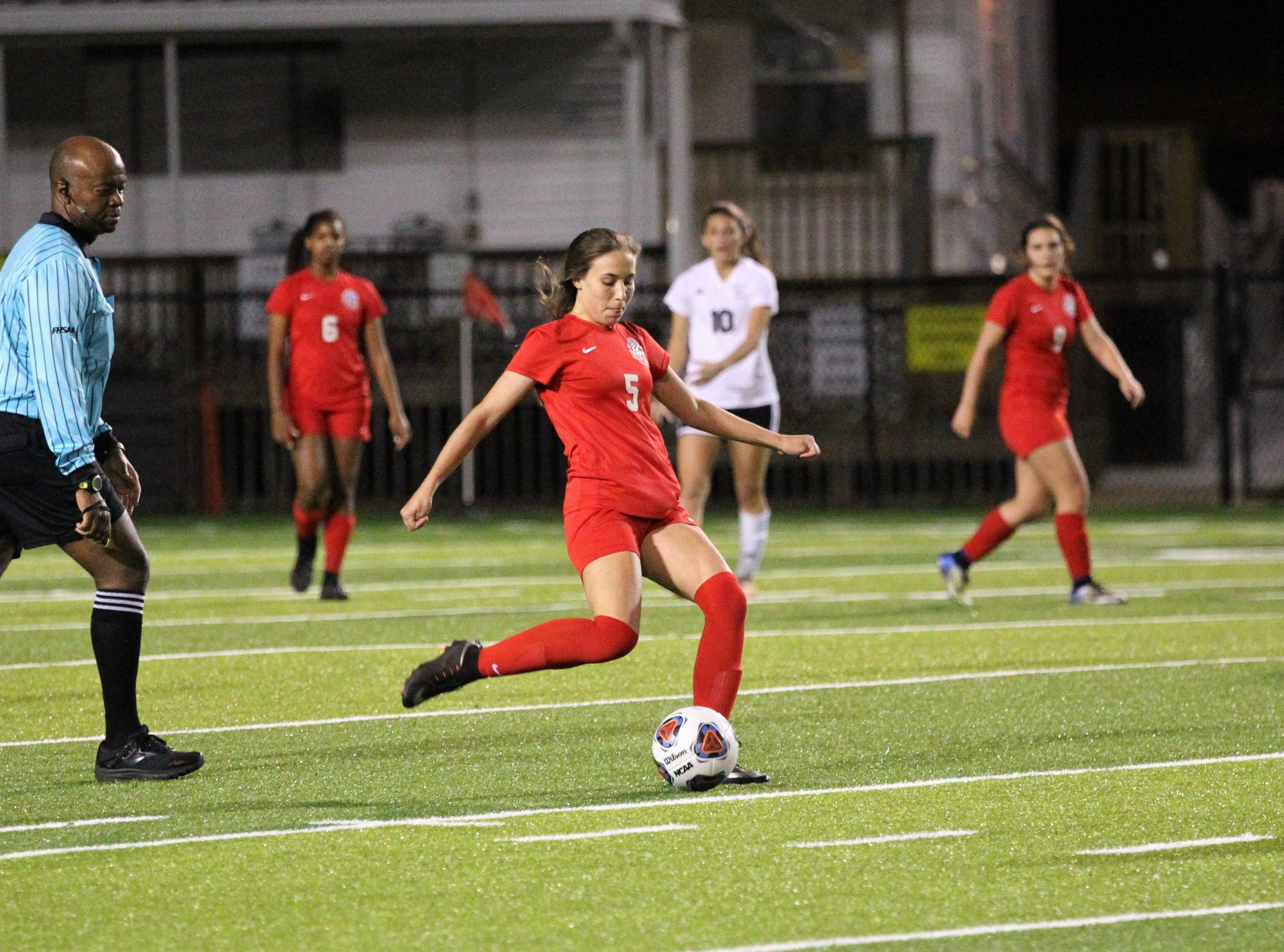 Leon's Allie Krikorian sends a pass upfield as Niceville's girls soccer team beat Leon 1-0 in a Region 1-4A semifinal at Gene Cox Stadium on Jan. 8, 2019.