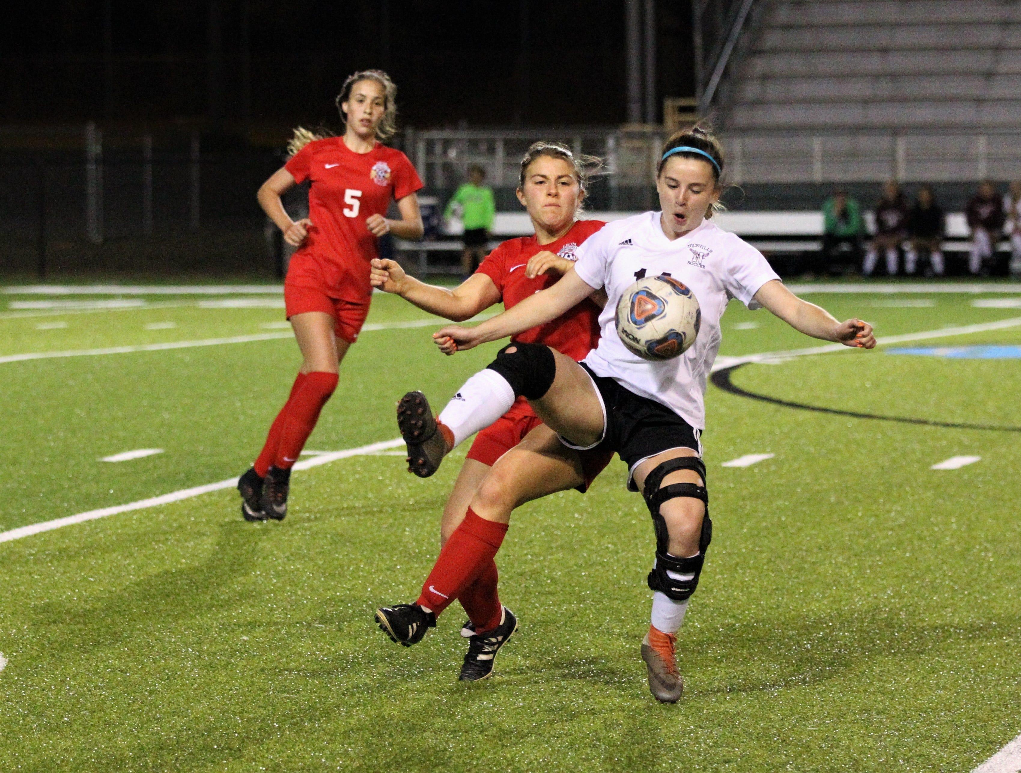 Leon's Callie Albrigo fights to gain possession as Niceville's girls soccer team beat Leon 1-0 in a Region 1-4A semifinal at Gene Cox Stadium on Jan. 8, 2019.
