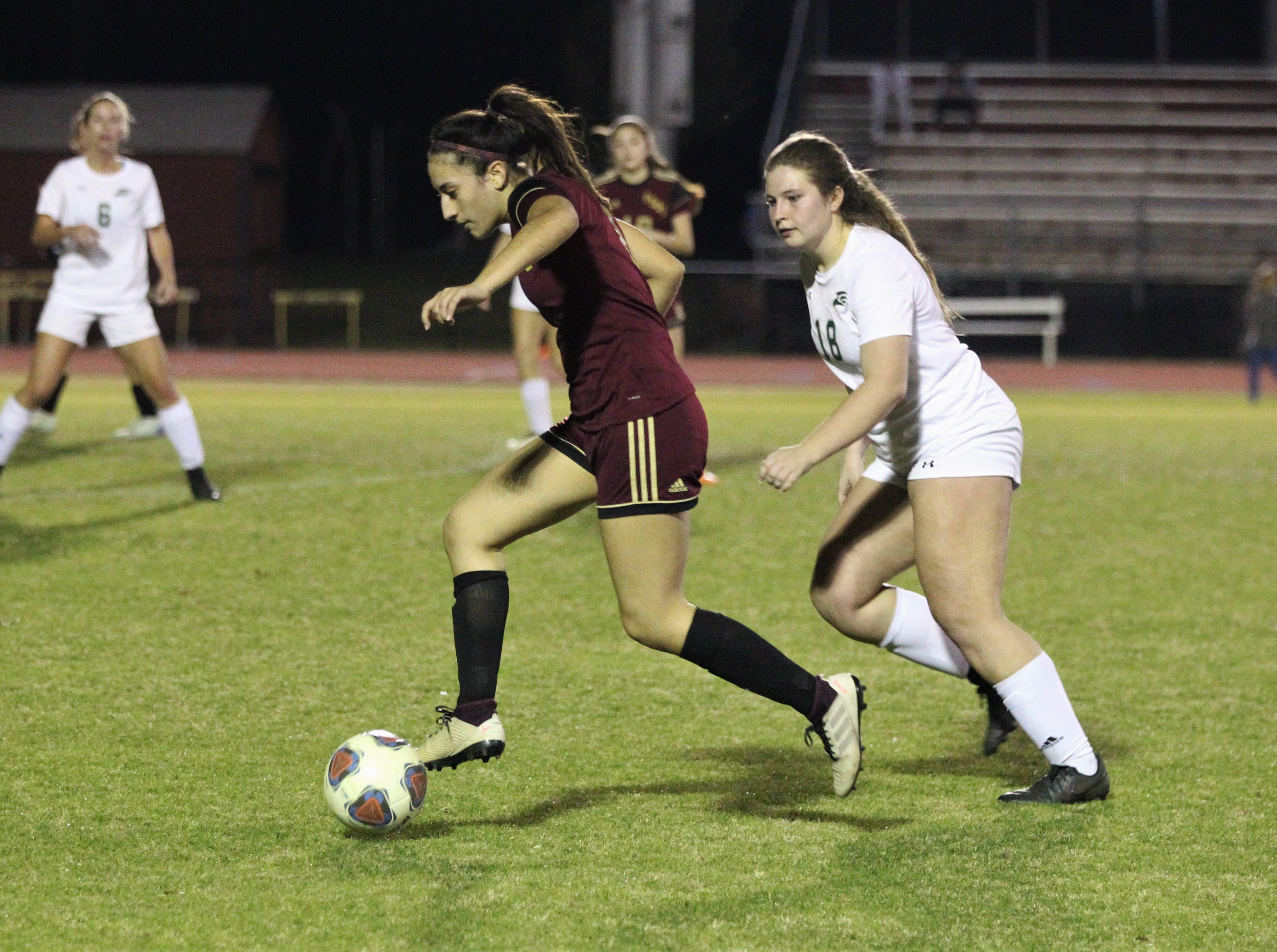 Florida High's Lily Quijada dribbles through the midfield as South Walton edged the Seminoles 5-4 in a penalty-kick shootout during a Region 1-2A semifinal on Feb. 8, 2019.