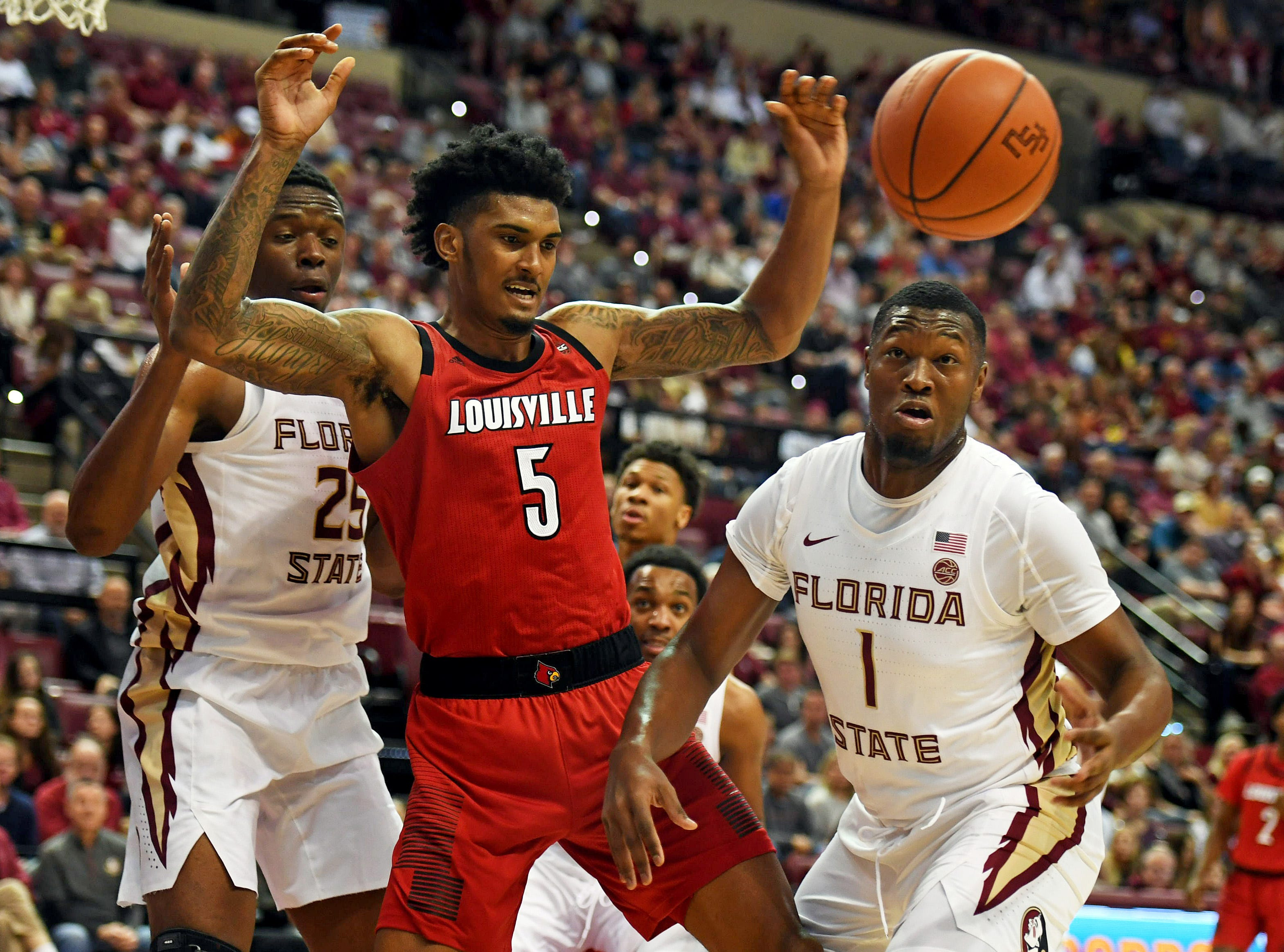 Feb 9, 2019; Tallahassee, FL, USA; Louisville Cardinals forward Malik Williams (5) fights for a loose ball against Florida State Seminoles forward Raiquan Gray (1) during the first half at Donald L. Tucker Center. Mandatory Credit: Melina Myers-USA TODAY Sports