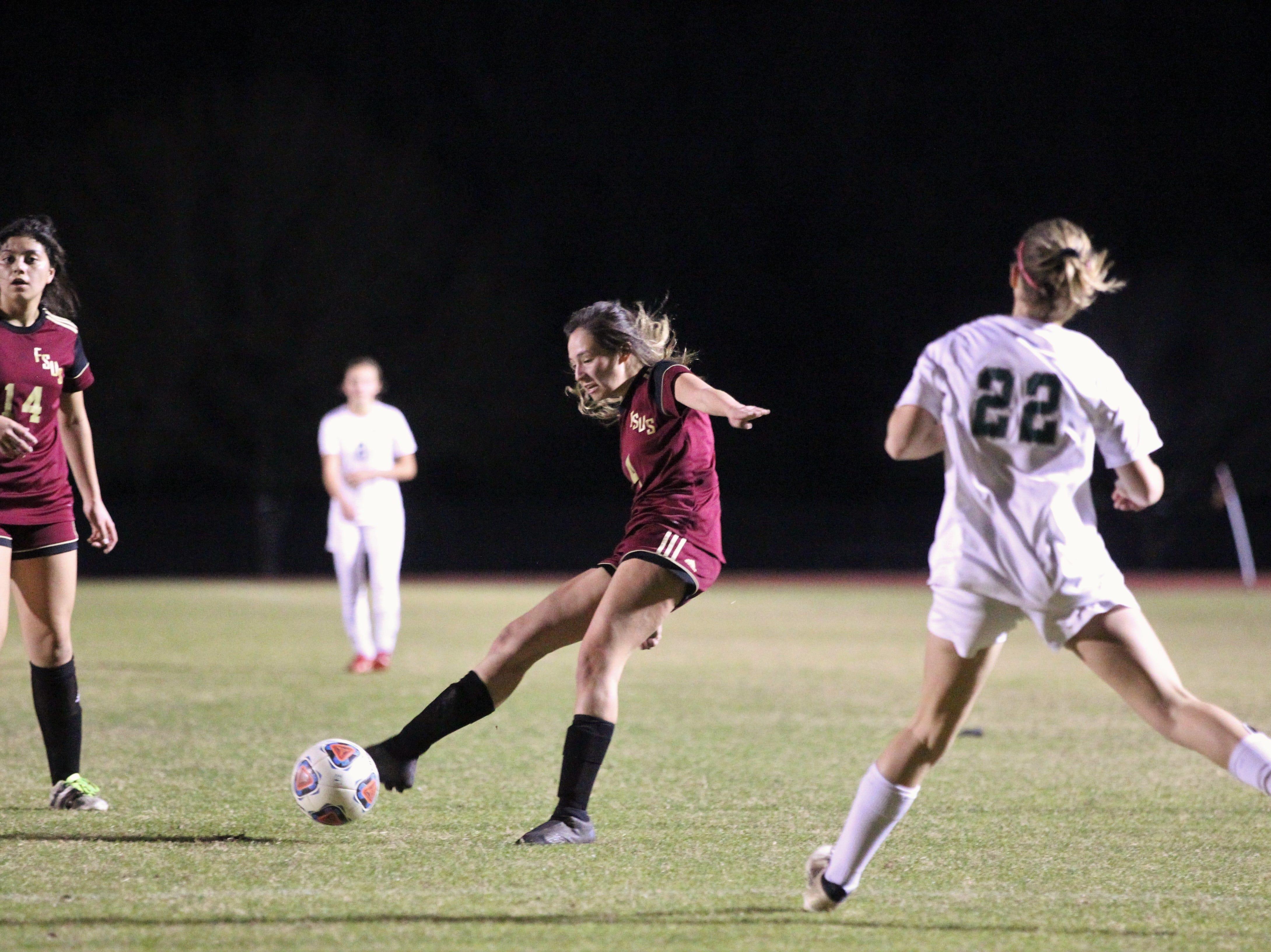 Florida High's Daphne Cervantes passes ahead as South Walton's girls soccer team edged the Seminoles 5-4 in a penalty-kick shootout during a Region 1-2A semifinal on Feb. 8, 2019.