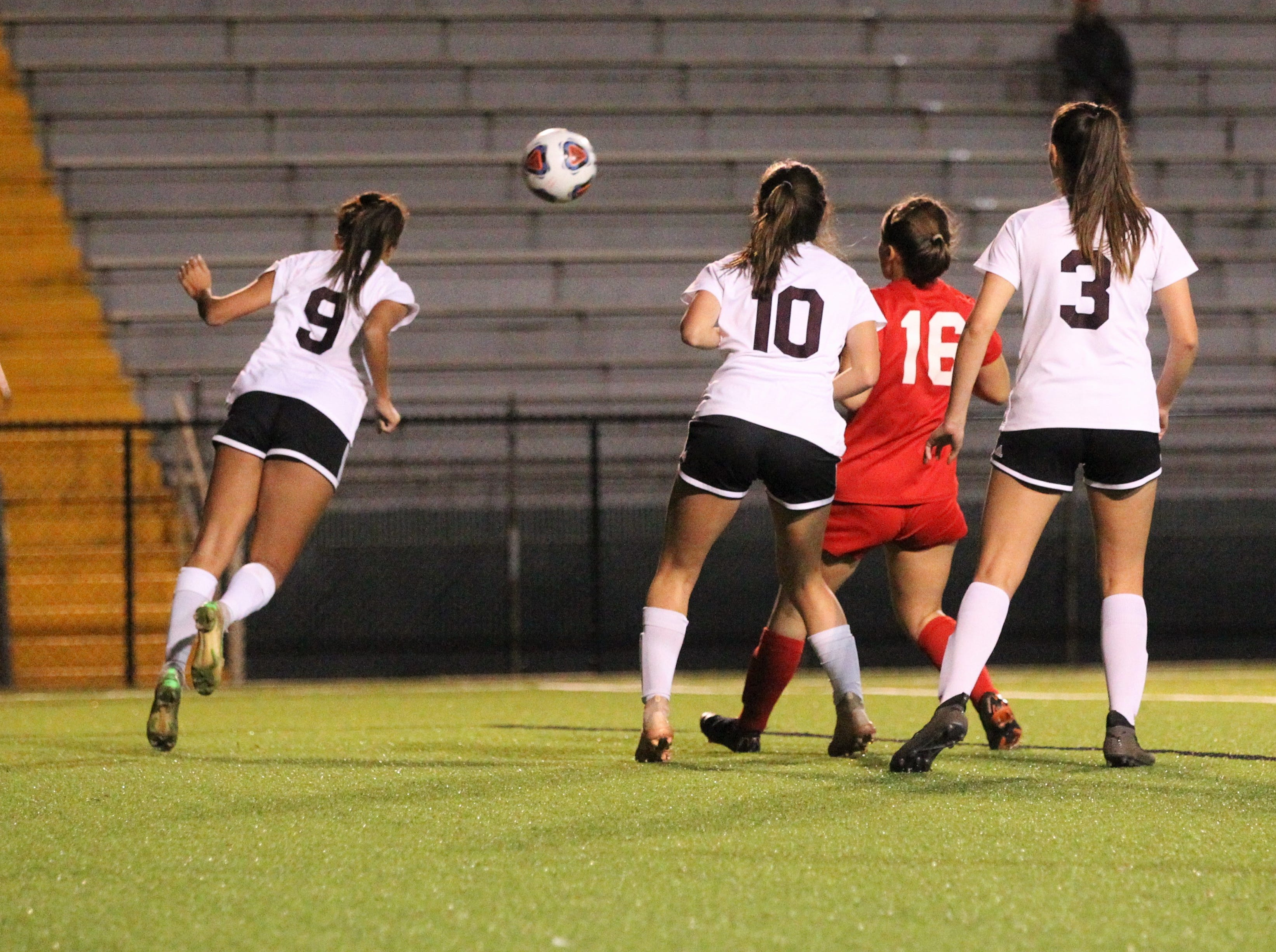 Niceville's Liliana Fernandez clears a ball with her head as Niceville's girls soccer team beat Leon 1-0 in a Region 1-4A semifinal at Gene Cox Stadium on Jan. 8, 2019.