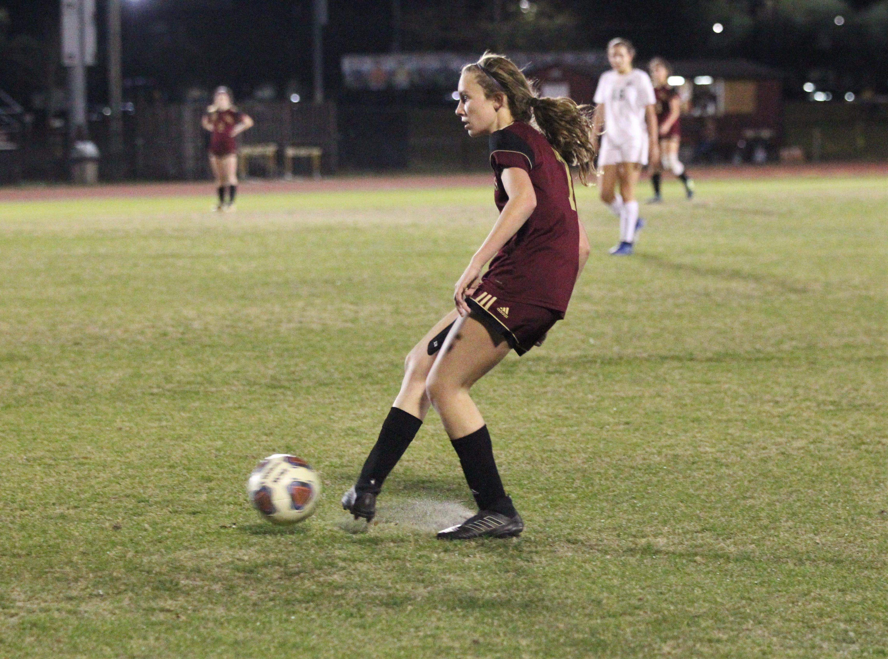 Florida High's Ava Dubois passes ahead as South Walton edged the Seminoles 5-4 in a penalty-kick shootout during a Region 1-2A semifinal on Feb. 8, 2019.