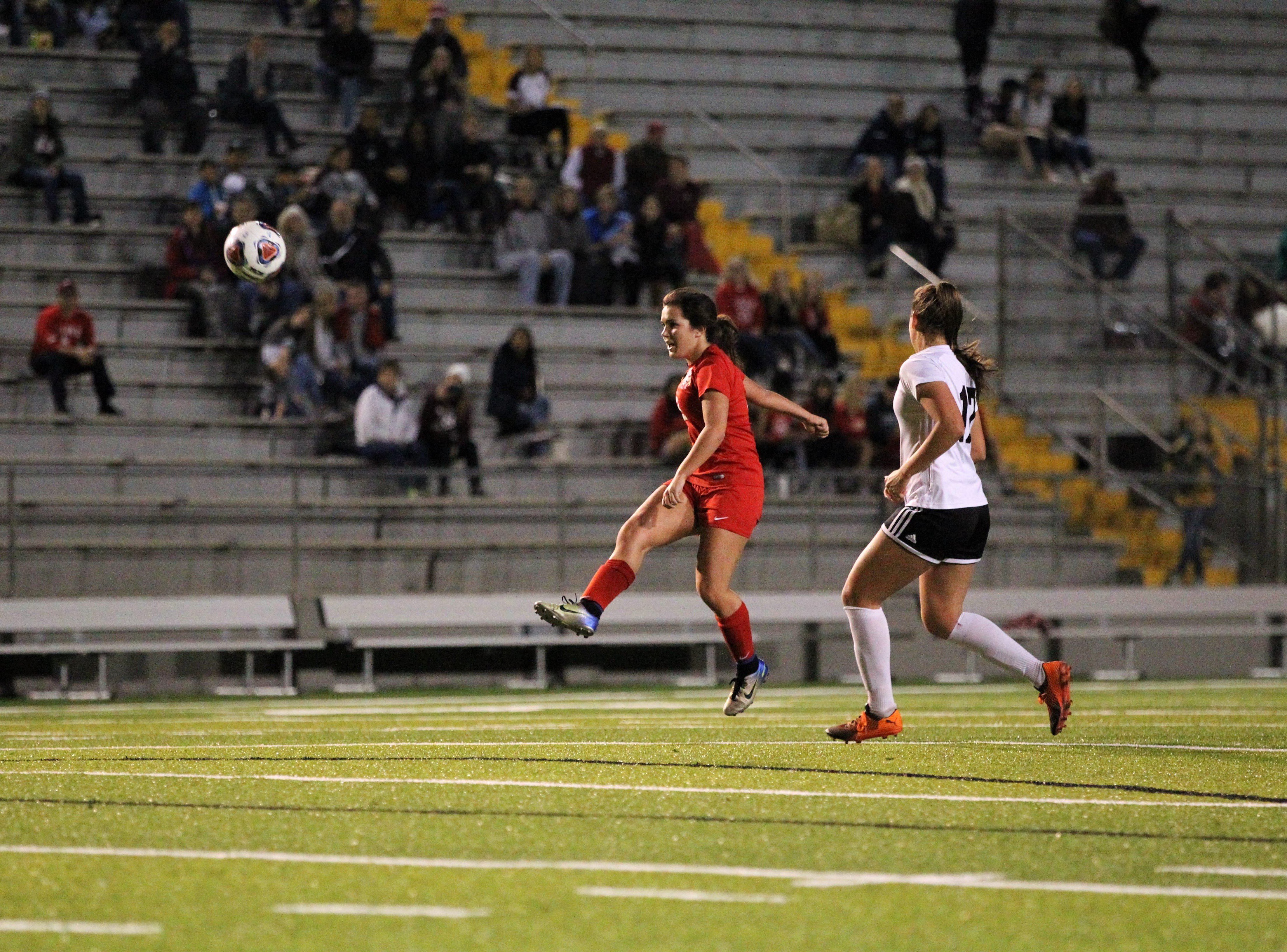 Leon's Ashley Fink sends a pass upfield as Niceville's girls soccer team beat Leon 1-0 in a Region 1-4A semifinal at Gene Cox Stadium on Jan. 8, 2019.