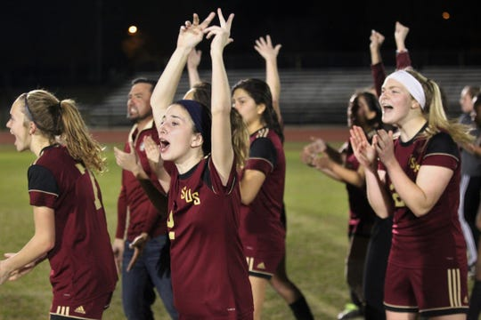Florida High's Grace McDaniel (2) and her teammates pump up the fans during a penalty-kick shootout as South Walton's girls soccer team edged the Seminoles 5-4 in PKs during a Region 1-2A semifinal on Feb. 8, 2019.