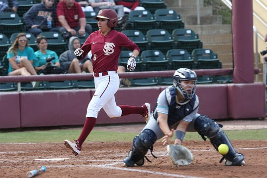 Florida State Seminoles outfielder Zoe Casas (6) scores a run as the Florida State Seminoles take on the UNC Wilmington Seahawks in their first game of the season at the Joanne Graf Stadium, Friday Feb. 8, 2019.