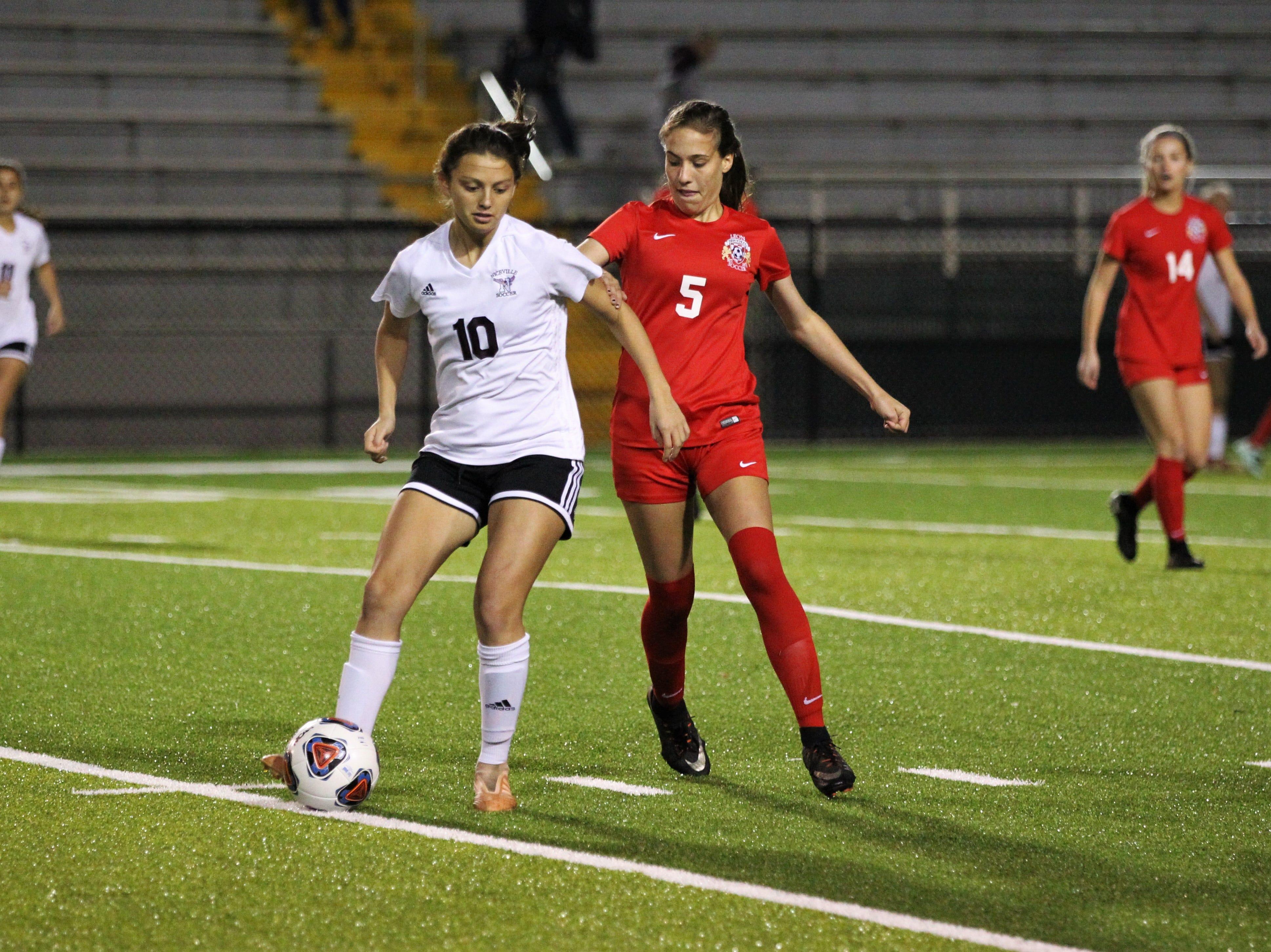 Leon's Allie Krikorian guards Niceville's Ashlyn Fernandez as Niceville's girls soccer team beat Leon 1-0 in a Region 1-4A semifinal at Gene Cox Stadium on Jan. 8, 2019.