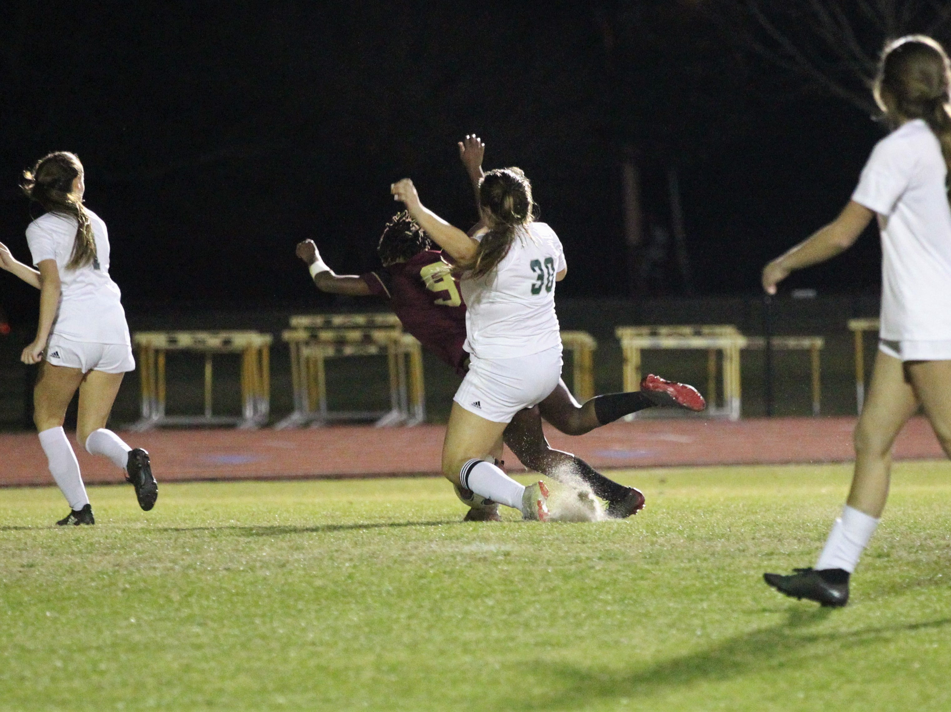 Florida High's Janae Scott gets pushed from behind in the box, but no foul was called, as South Walton edged the Seminoles 5-4 in a penalty-kick shootout during a Region 1-2A semifinal on Feb. 8, 2019.