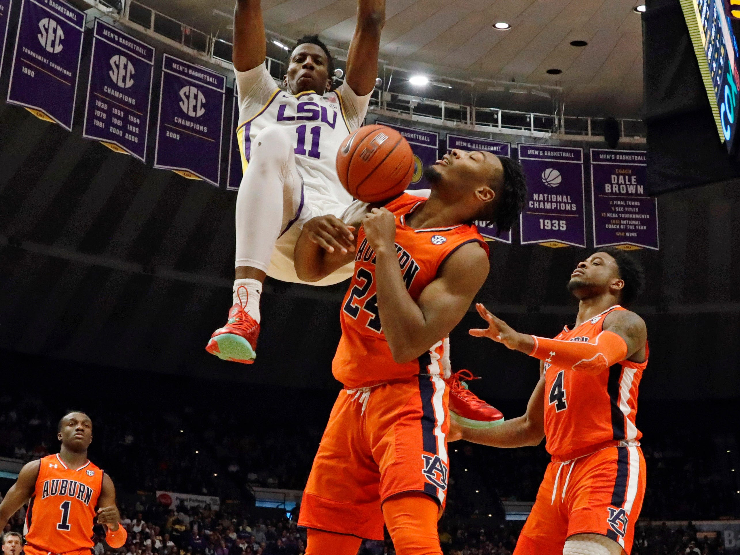 Feb 9, 2019; Baton Rouge, LA, USA;  LSU Tigers forward Kavell Bigby-Williams (11) dusk the ball against Auburn Tigers forward Anfernee McLemore (24) in the second half at Maravich Assembly Center. Mandatory Credit: Stephen Lew-USA TODAY Sports